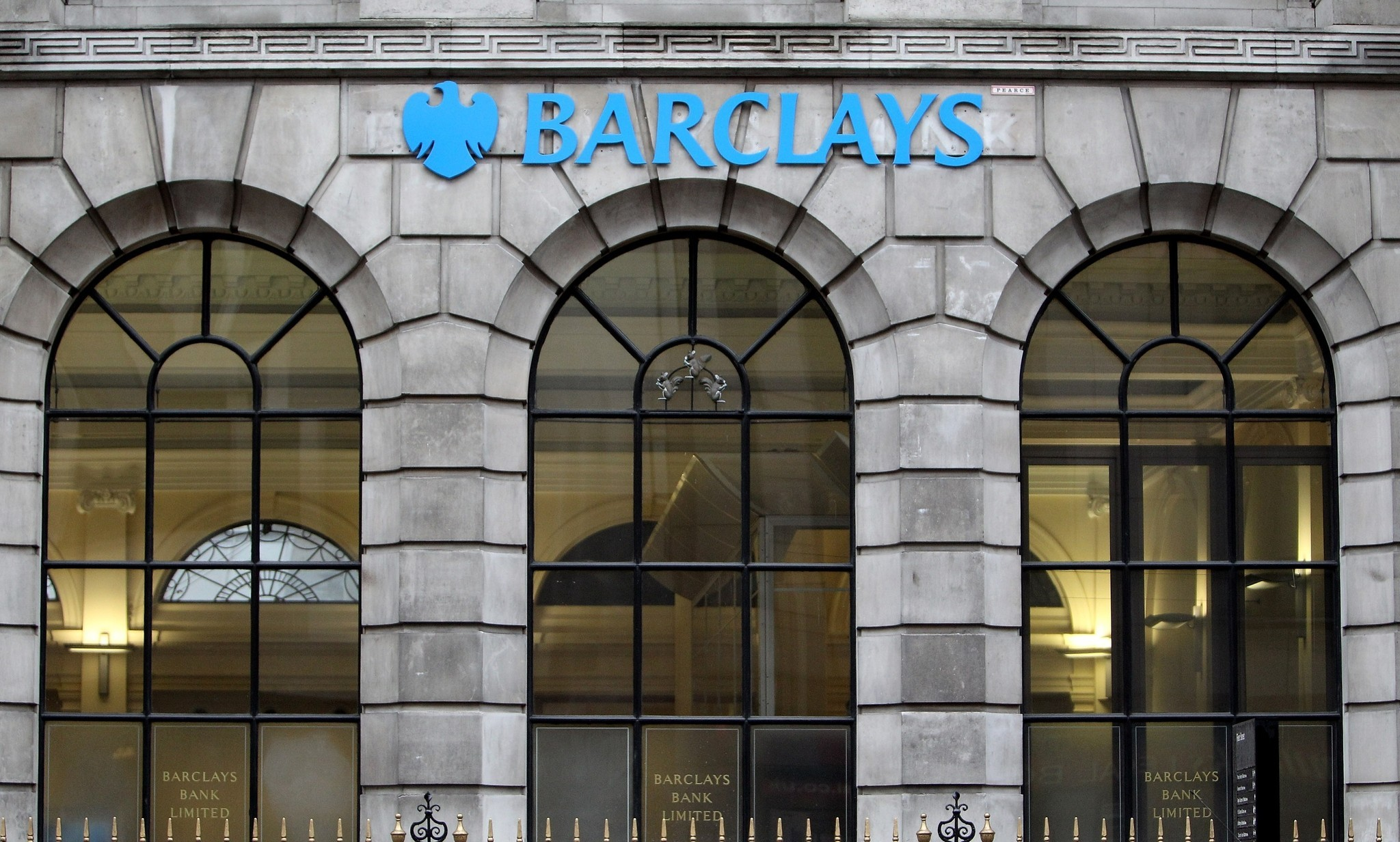 Britain charges three ex-Barclays employees in interest-rate probe