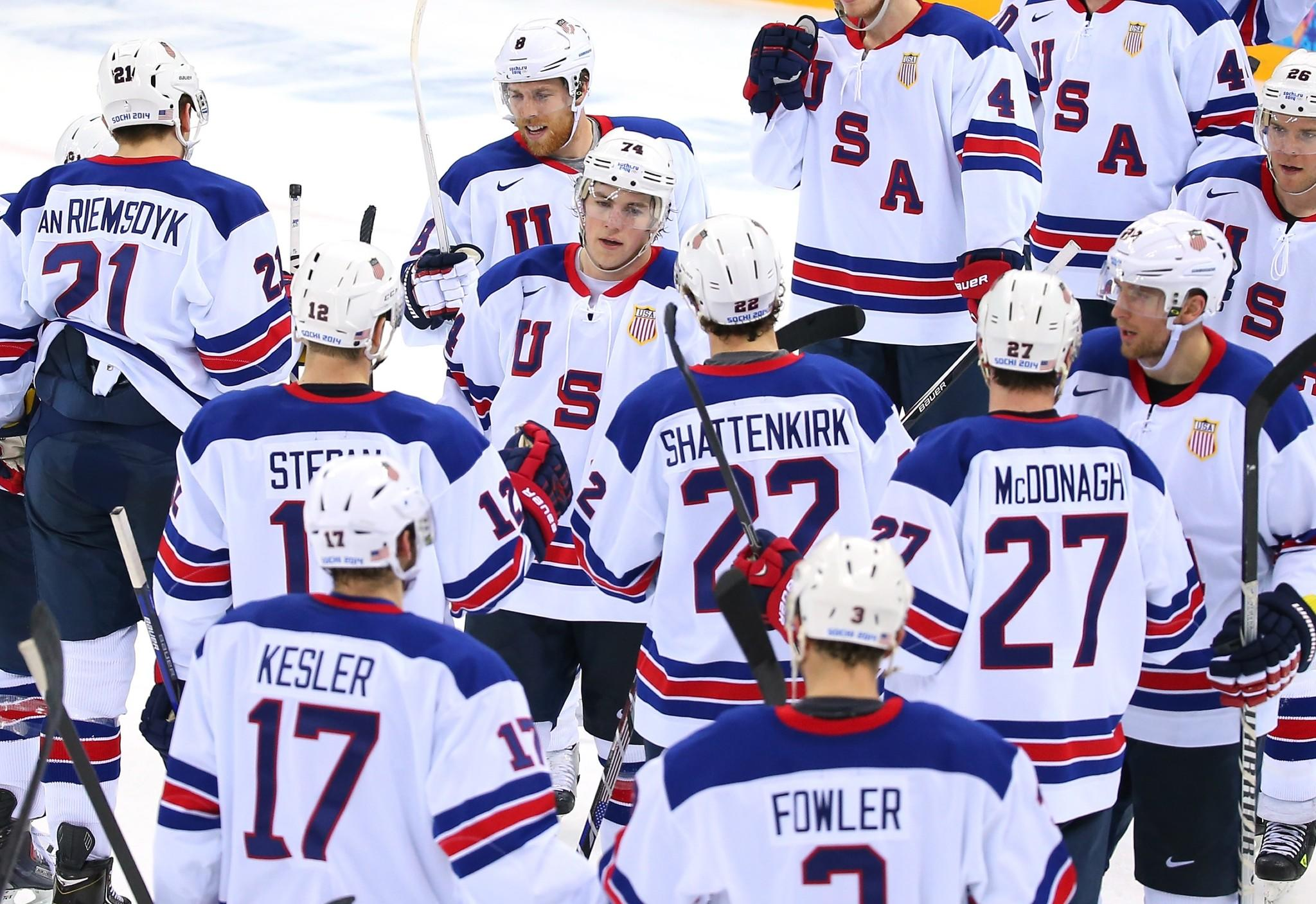 T.J. Oshie (center)shakes hands with teammates after the U.S team beat Slovenia 5-1 Sunday.