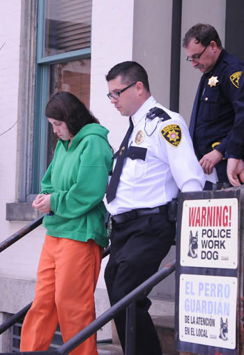 Miranda Barbour, 19, is led out of Northumberland County Courthouse last December. She and her husband, Elytte Barbour, 22, are charged in the murder of a man they allegedly lured to a rendezvous through a Craigslist ad.