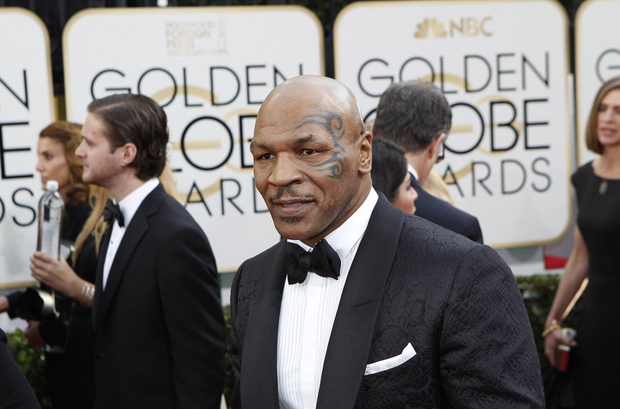 Mike Tyson arrives for the 71st Annual Golden Globe Awards.