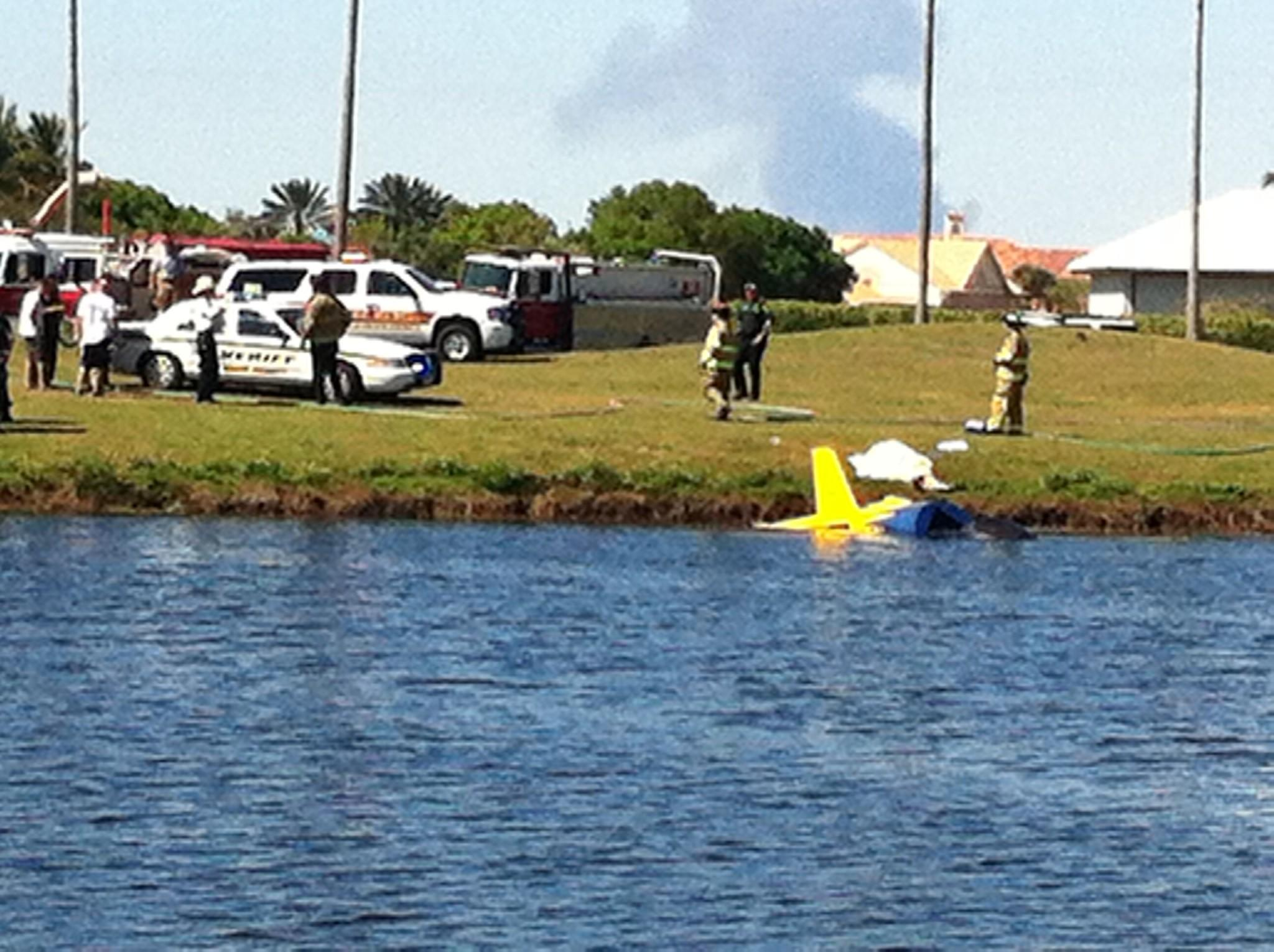 The tail of the Sonex aircraft can be seen at the edge of a lake in Wellington. The FAA said the homebuilt aircraft crashed while the pilot was practicing landings and takeoffs at the Wellington Aero Club.