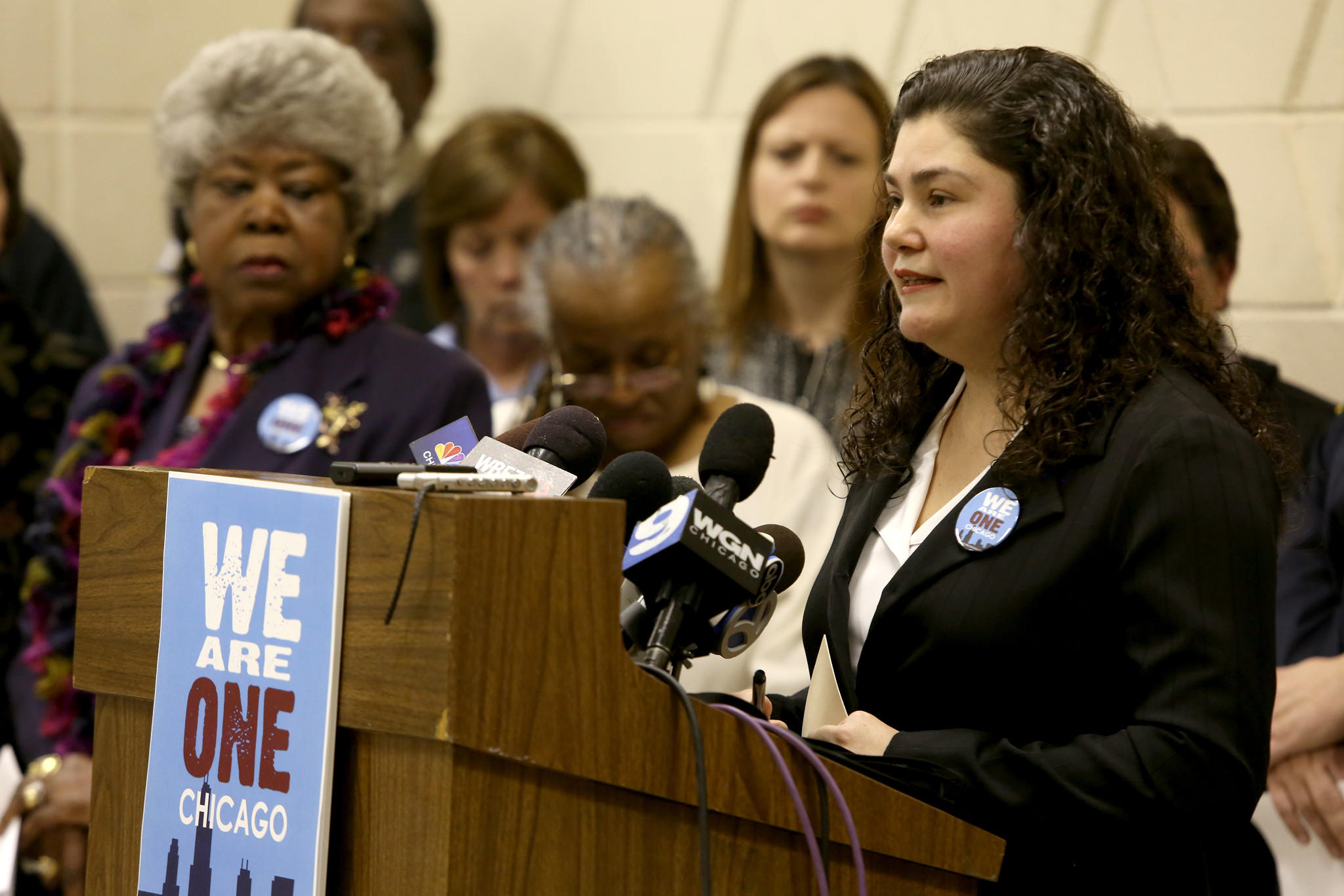 Public health nurse Guadalupe Alcazar joins city of Chicago workers, union members, teachers, nurses and police retirees to announce the forming of a new coalition - We Are One Chicago.