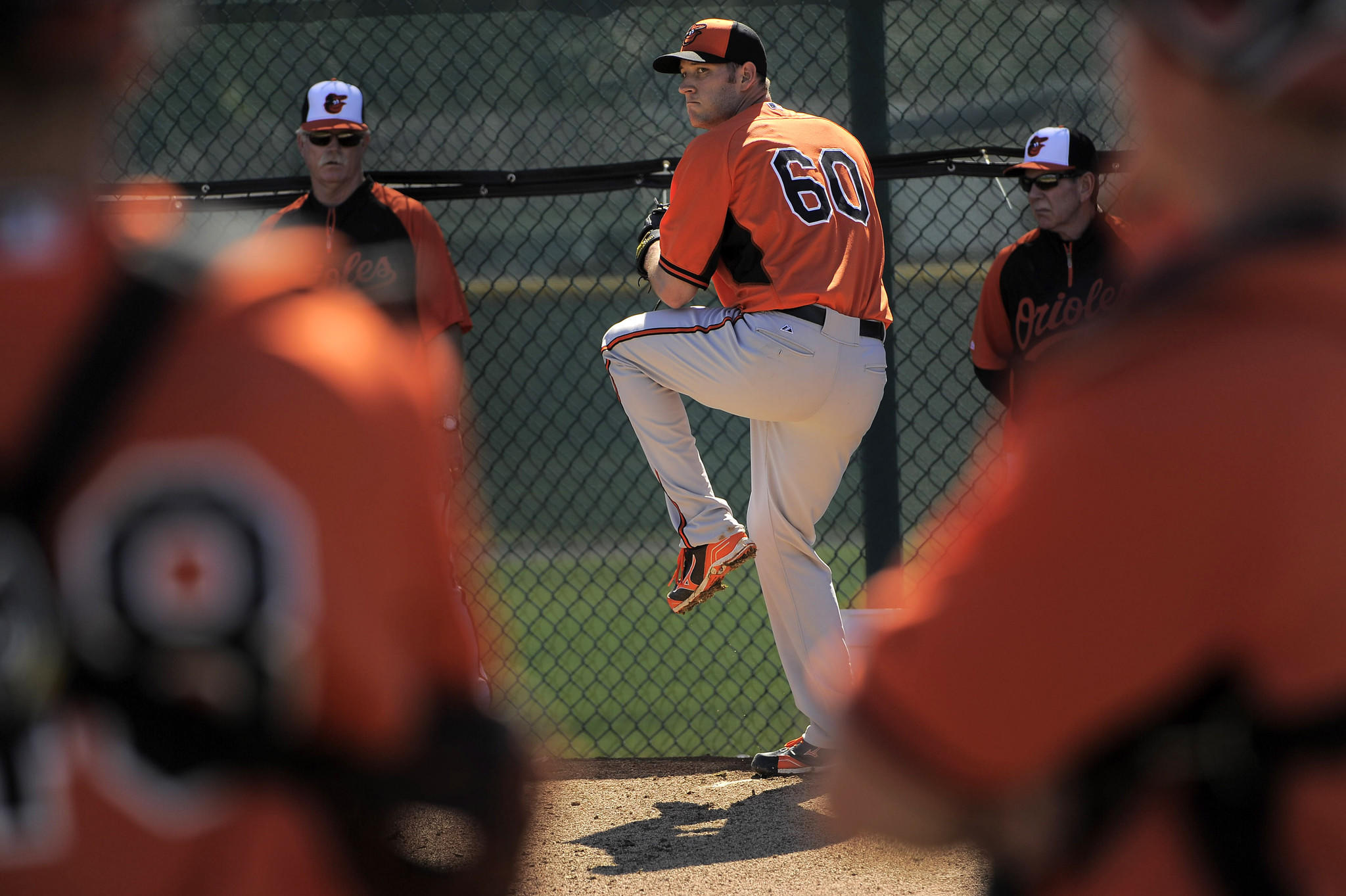 Josh Stinson throws during workouts at the Orioles' spring training facility.