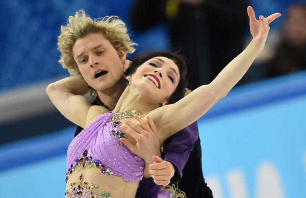 Americans Charlie White, left, and Meryl Davis won the gold medal in figure skating ice dance at the Sochi Winter Olympic Games on Monday. The couple made history in an emotionally exhausting performance that quieted critics.