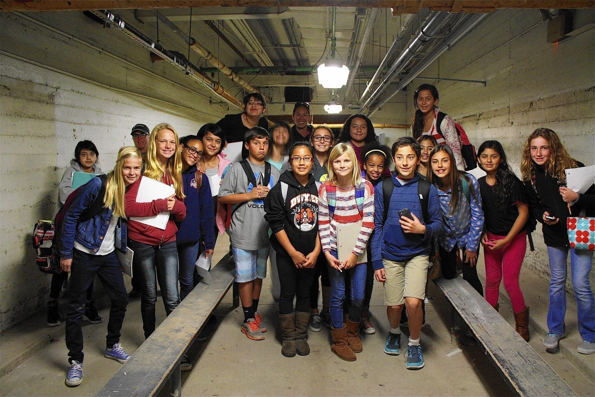 Student from the sixth grade at Dwyer Middle School tour the underground of their school in search of inspiration (and possibly Ethel Dwyer's ghost).