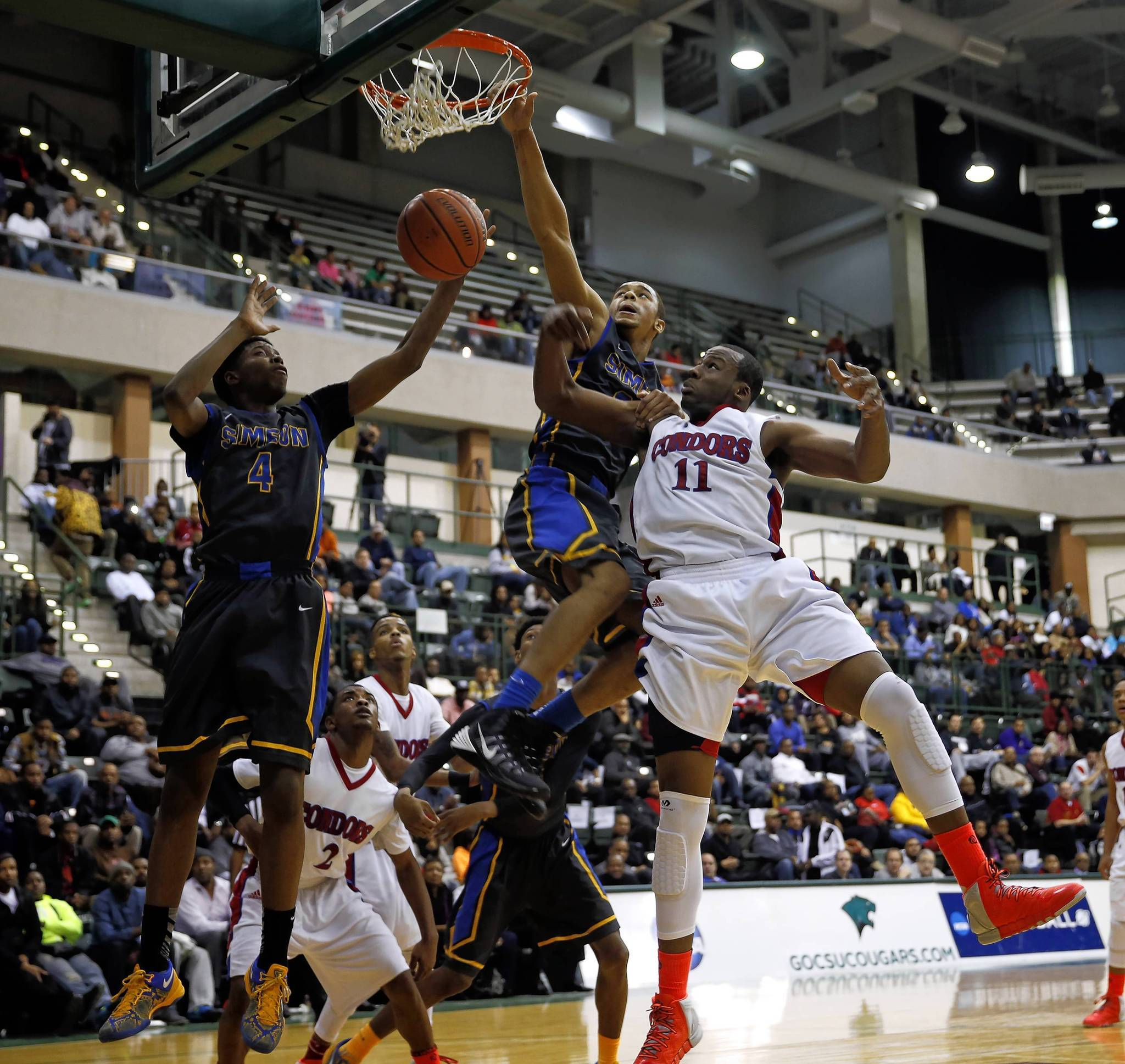 Simeon's Edward Morrow misses a dunk attempt against Curie's Cliff Alexander.
