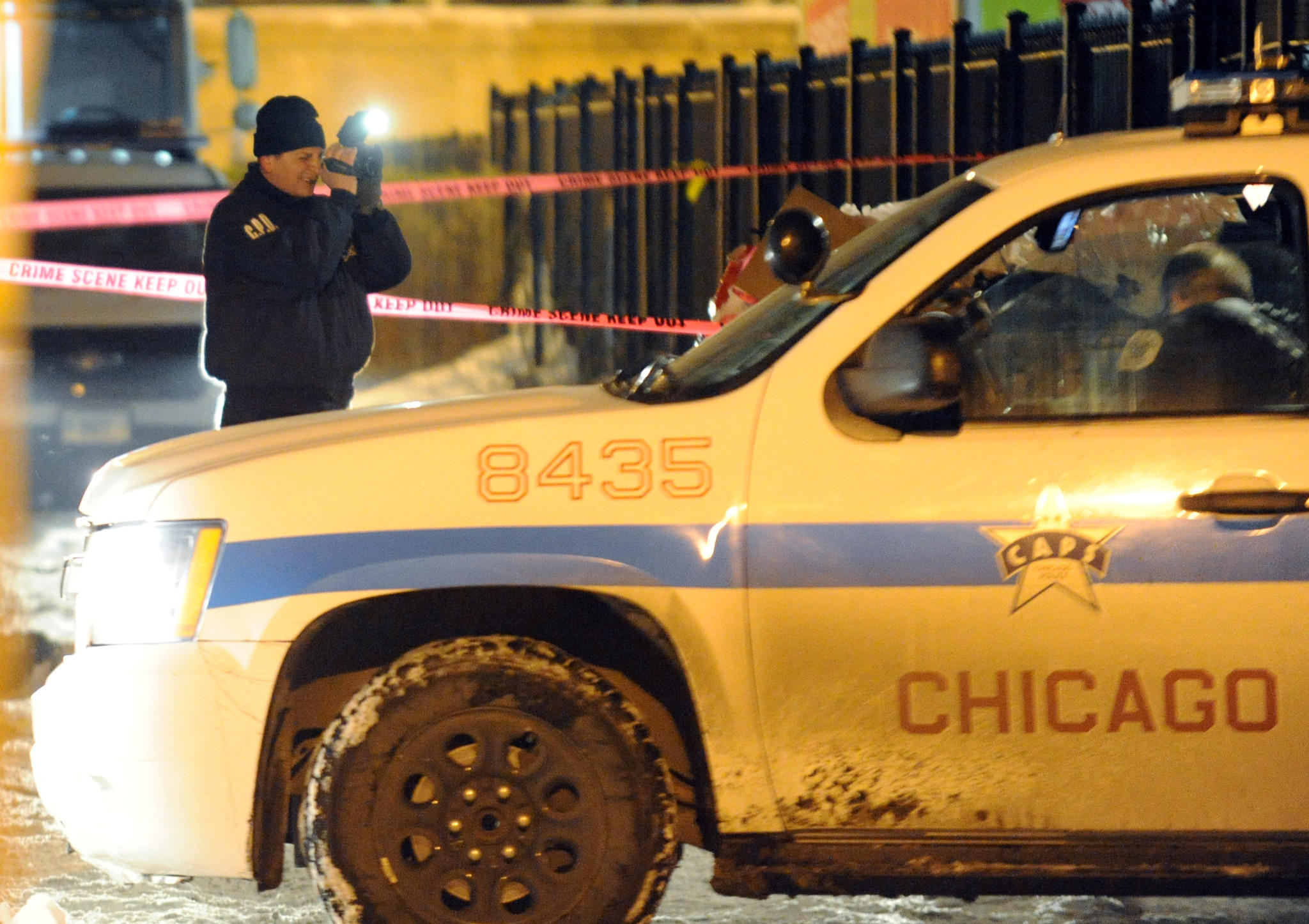 Chicago police officers on the scene of a shooting on the 300 block of North Parkside Avenue on Thursday.