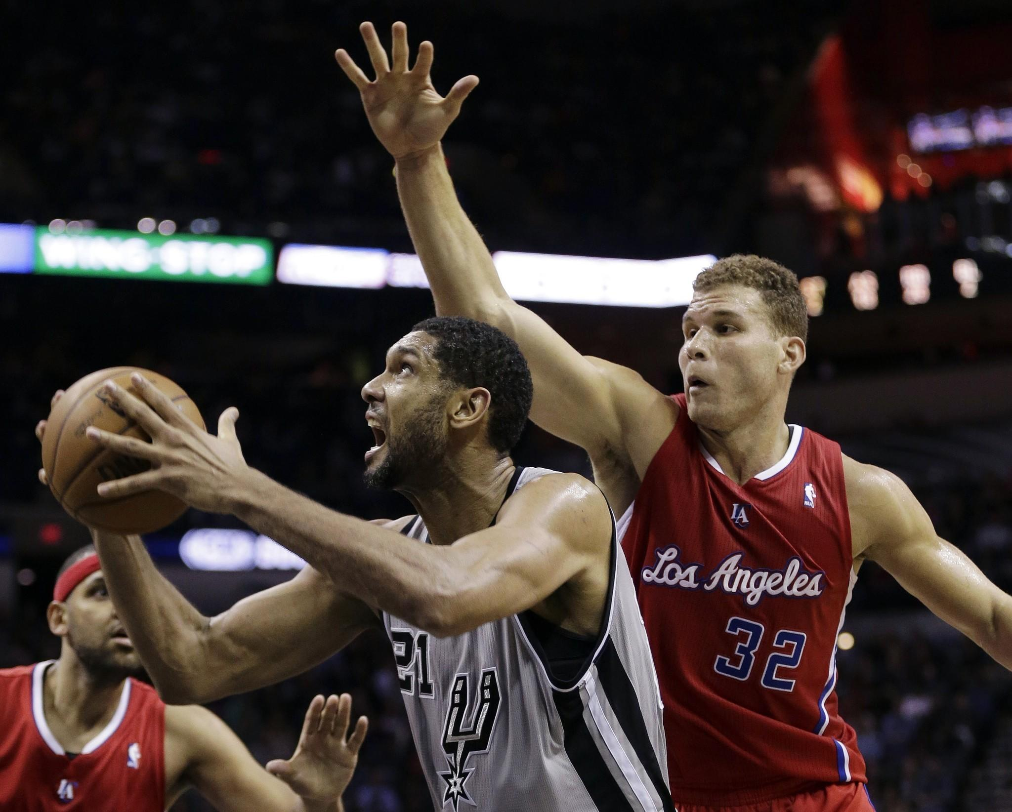 Spurs power forward Tim Duncan tries to power his way to the basket against Clippers power forward Blake Griffin during a game last month in San Antonio.