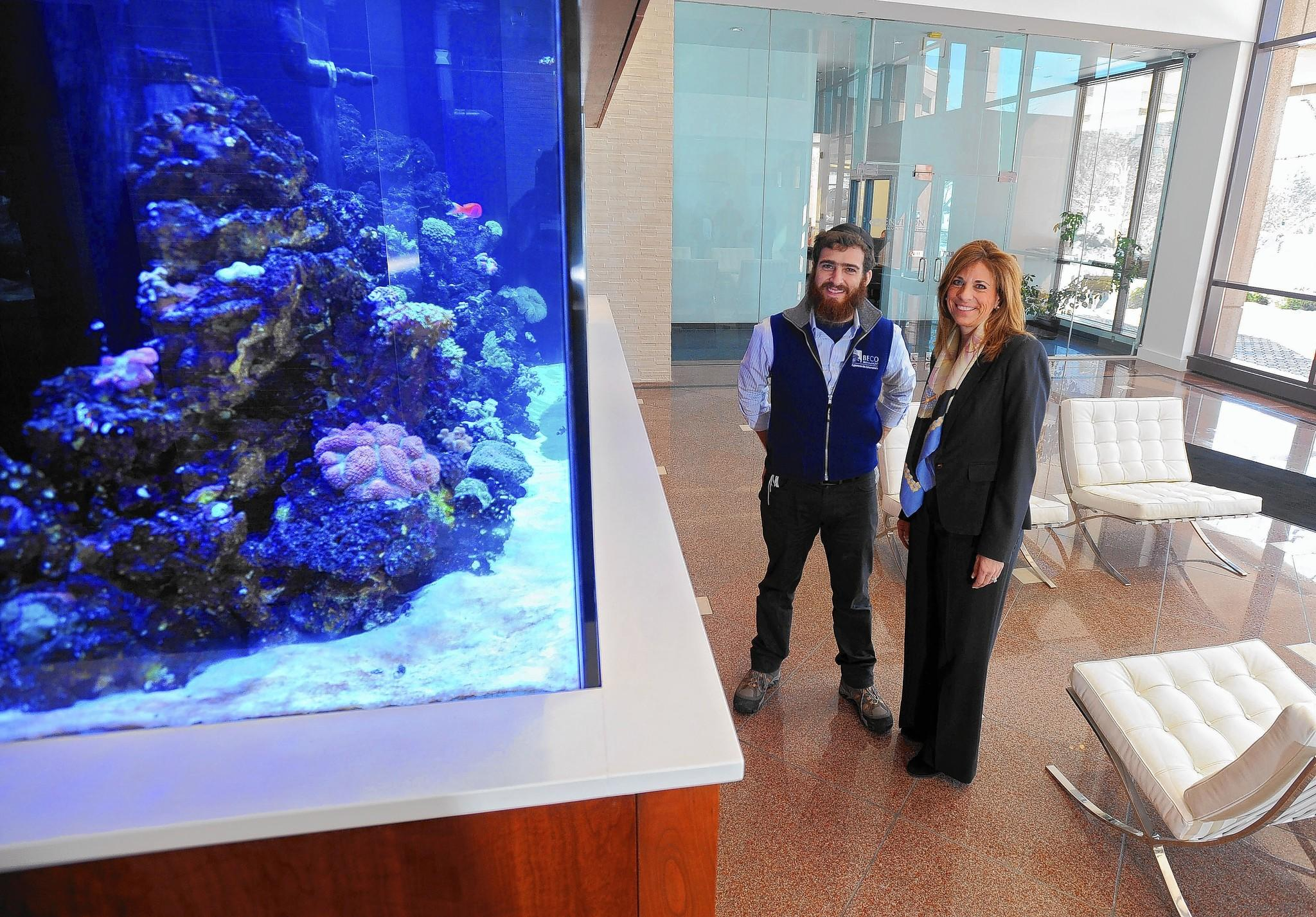 Roberta Levy Liss (right) and Levi Cohen of Beco Management say fish tanks and other high-end amenities help their office properties stand out in a crowded market.