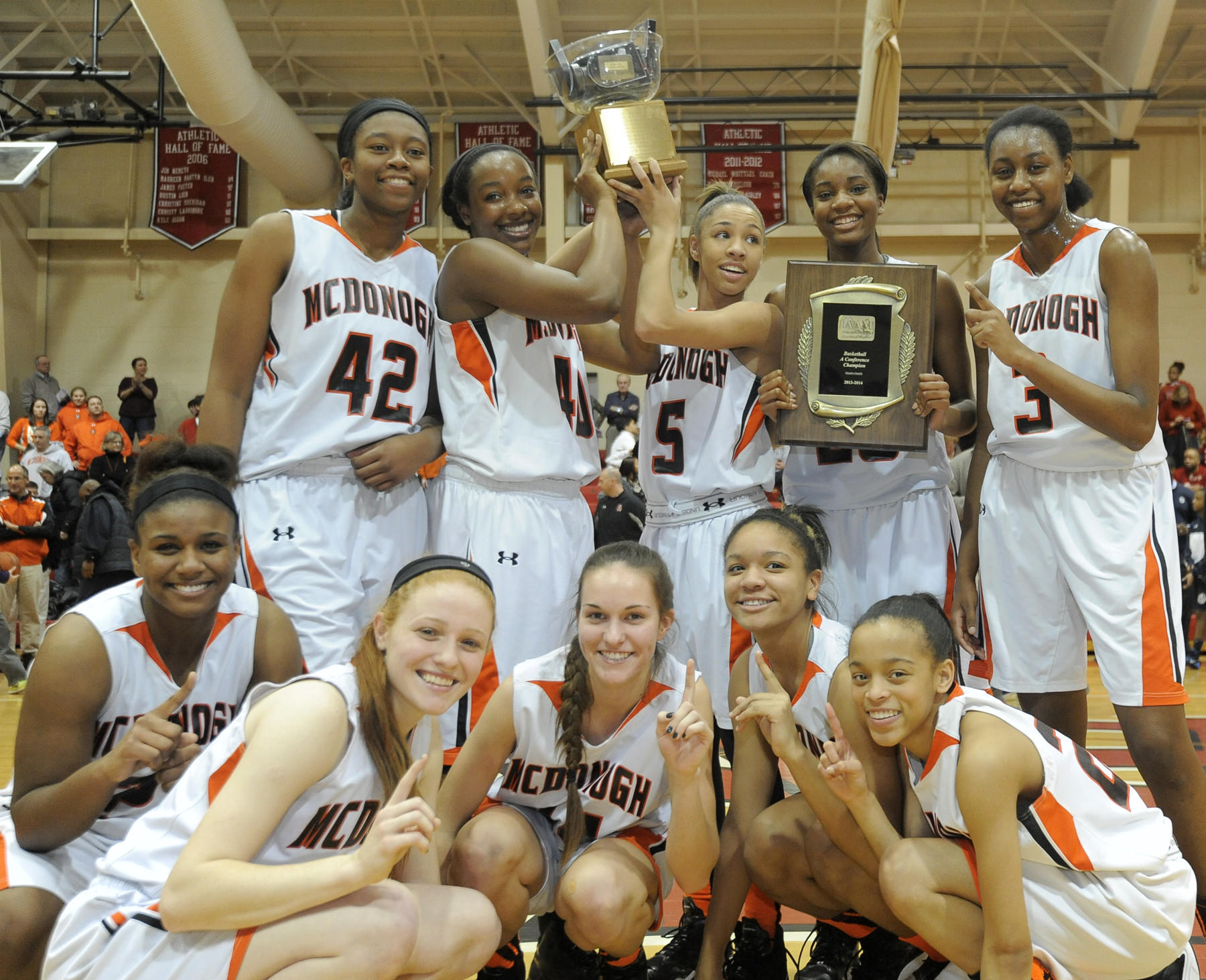 McDonogh girls celebrate a victory over Roland Park Country School for the IAAM A Conference championship.