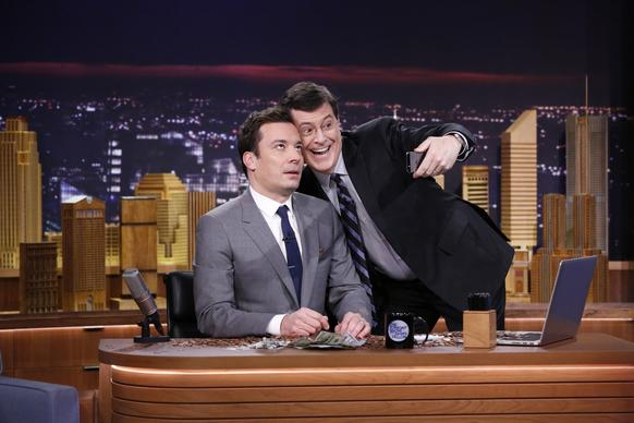"Fellow talk show host Stephen Colbert shamelessly takes a selfie with Jimmy Fallon, who rolled out his first show as host of NBC's ""The Tonight Show."" The program was previously hosted by Jay Leno."