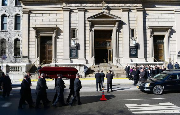 The casket carrying late actor Philip Seymour Hoffman arrives at St. Ignatius of Loyola Church.