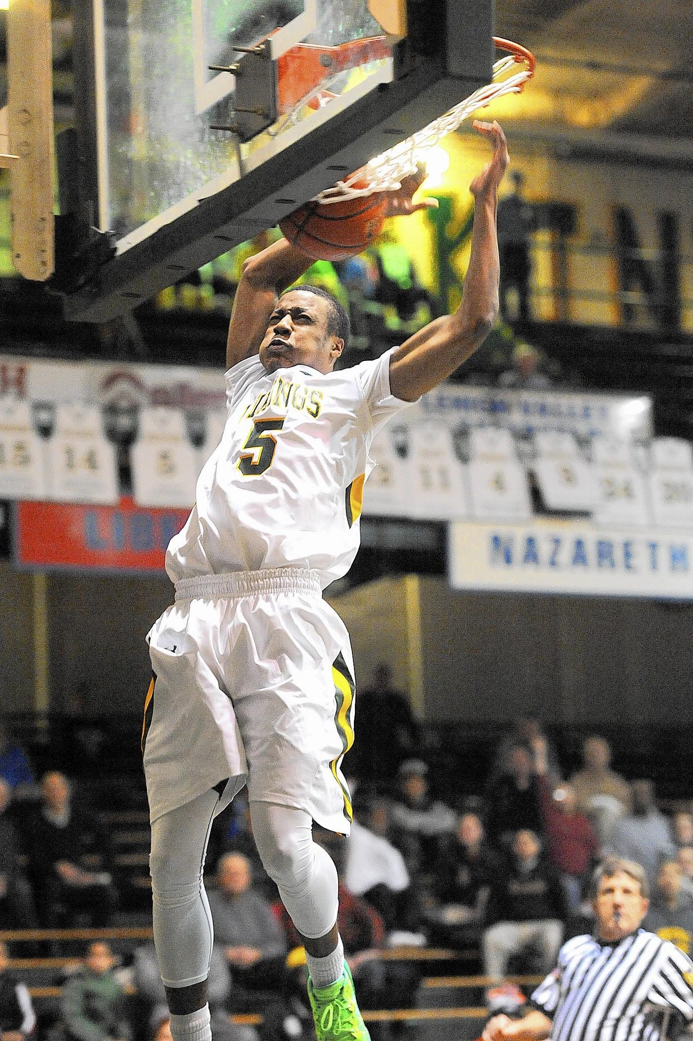 Central Catholic's Muhammad-Ali Abdur-Rahkman slams home a dunk earlier this year. The Vikings enter the District 11 tournament 24-0.