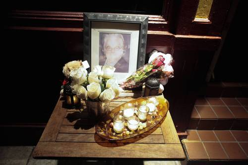A portrait and flowers in memory of actor Philip Seymour Hoffman is displayed outside the Philip Marie Restaurant and bar on Hudson Street in Manhattan.