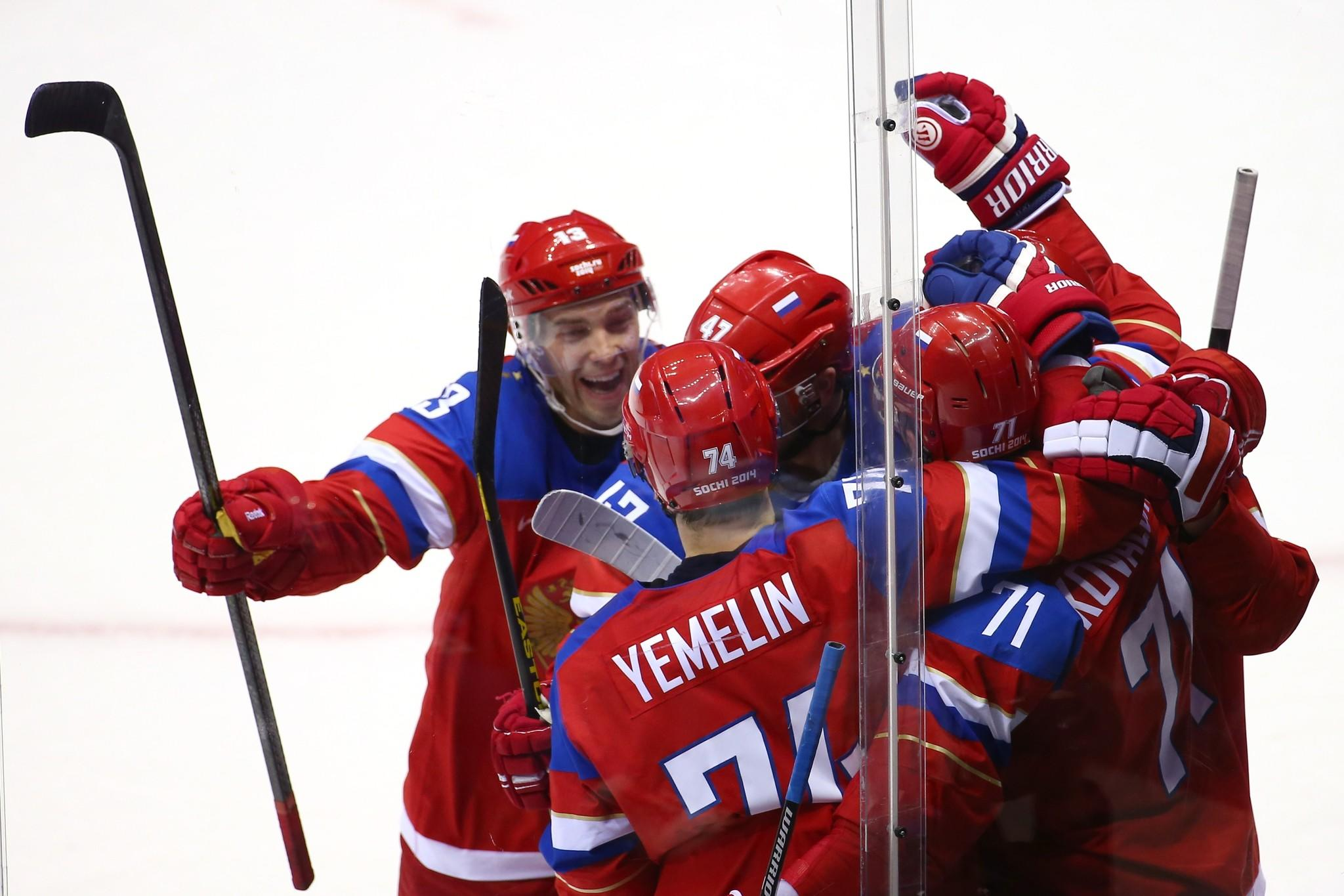 Alexander Radulov (left) of Russia celebrates with his teammates after scoring a goal.
