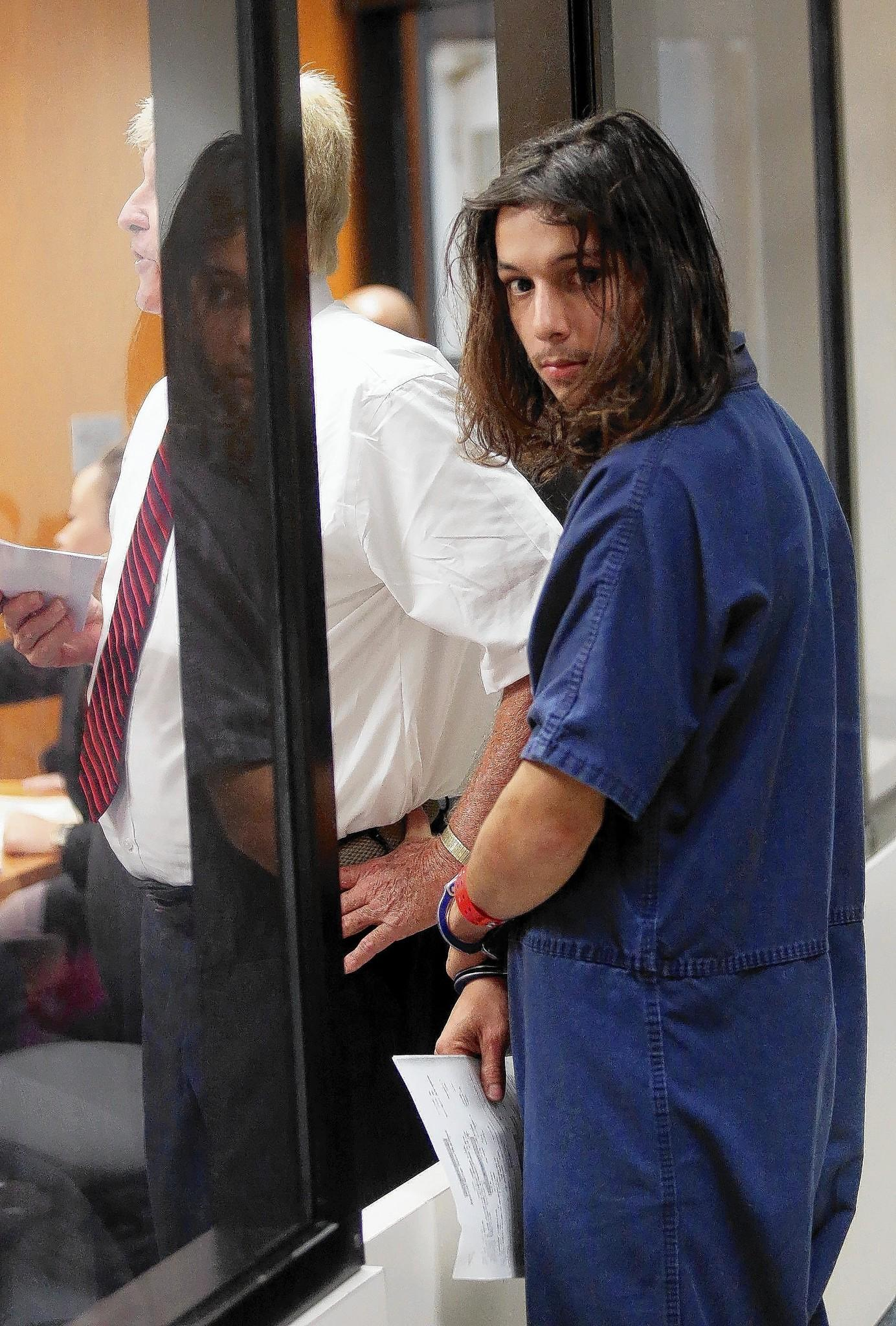 Christopher Rodriguez, 19, has his first appearance on charges of first-degree premeditated murder at the the John E. Polk Correctional Facility in Seminole county, on Tuesday, January 21, 2014. (Ricardo Ramirez Buxeda / Orlando Sentinel)