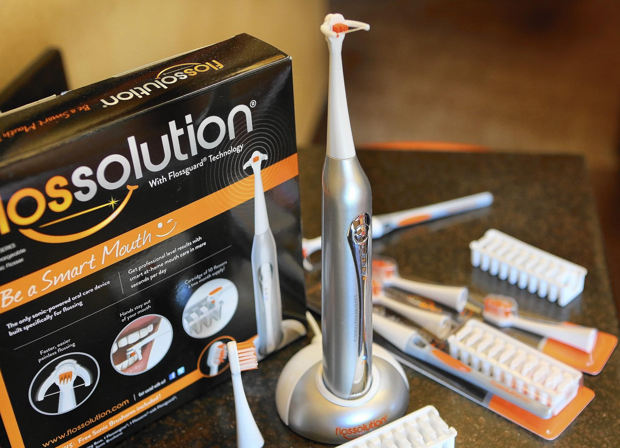 Dr. Tim Pruett, a Lake County dentist, has created a new way to floss teeth. He created the Flossolution, which is sold on Amazon.com and through dental offices and at its website: flossolution.com. The device has been awarded one patent, and has three others pending. Pruett decided to figure out a way to make it easier to floss correctly and eliminate all the reasons patients told him they don't floss: It hurts, it makes my gums bleed, the floss gets stuck, it takes too long, I don't like putting my fingers in my mouth. (Tom Benitez/OrlandoSentinel)
