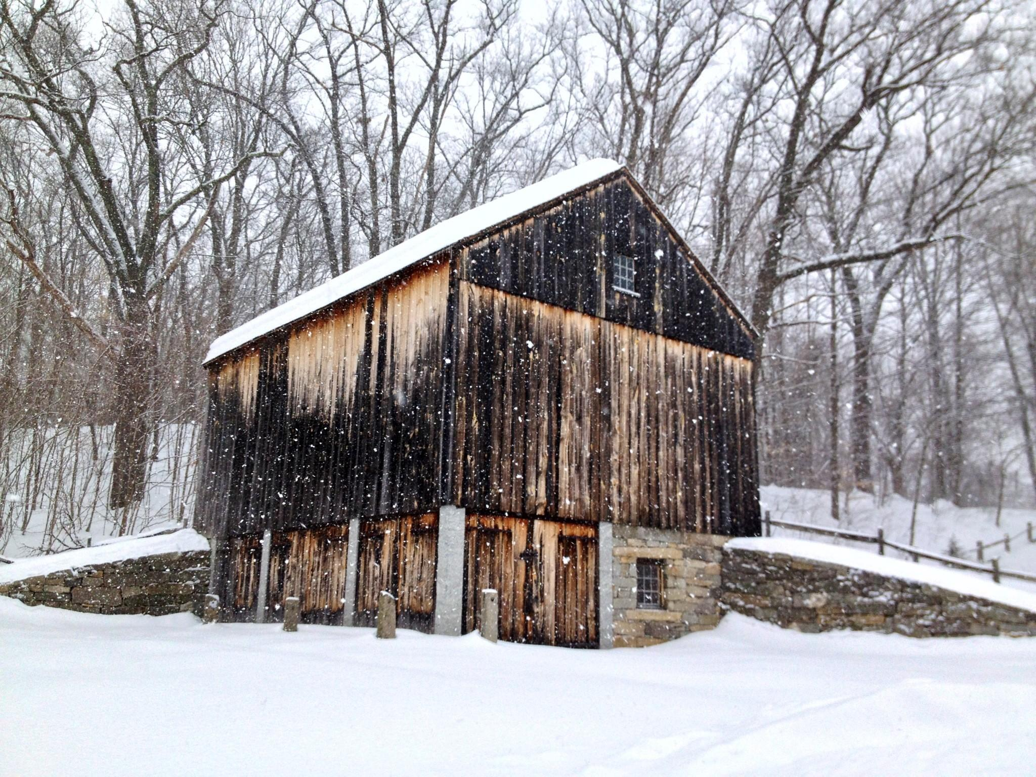 A barn on the grounds of the Welles Shipman Ward House in the snow.
