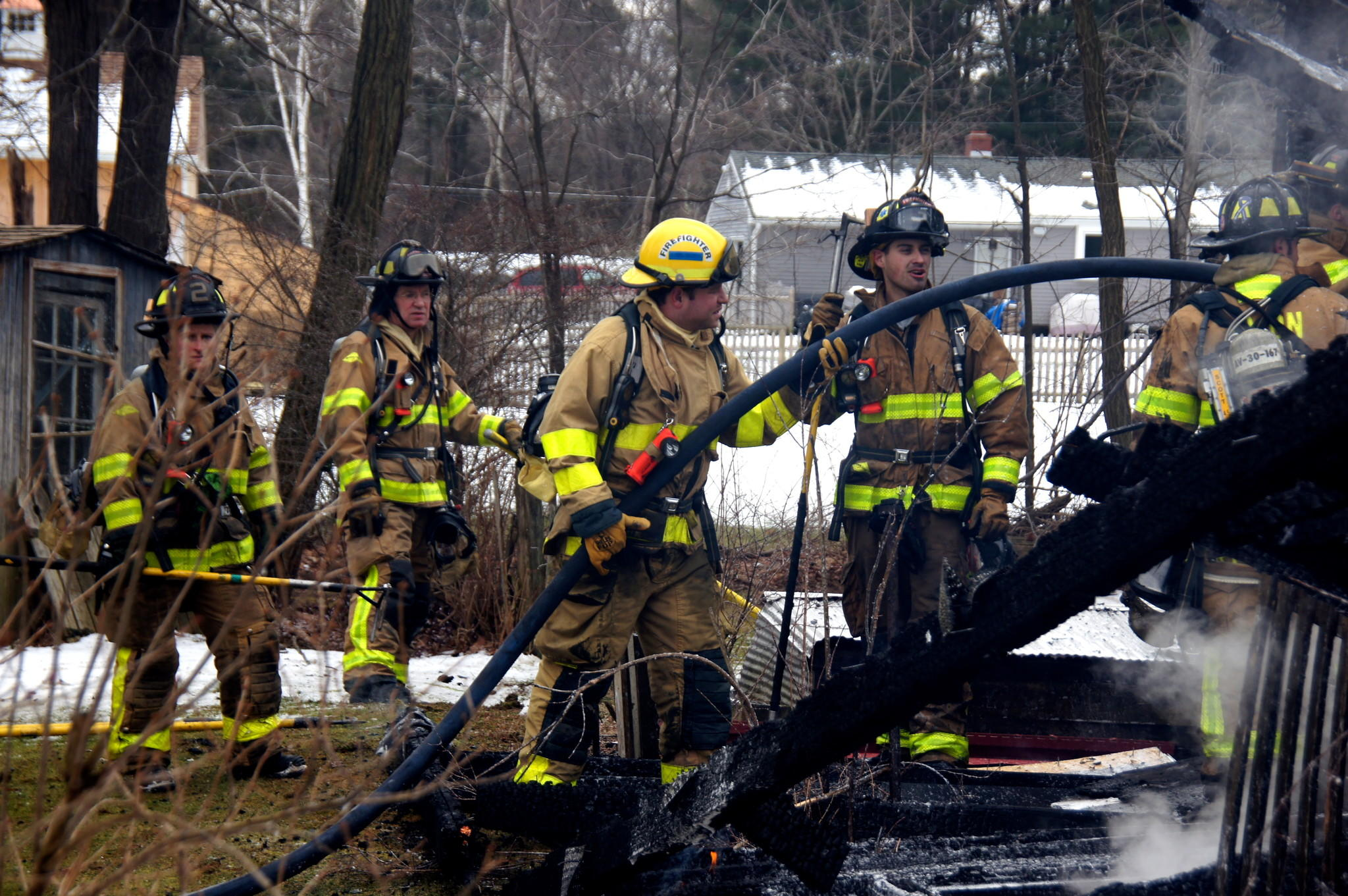 Members of the Avon Volunteer Fire Department at the scene of a recent fire. A citizens fire academy the department is offering this spring will let residents learn more about what firefighters do.