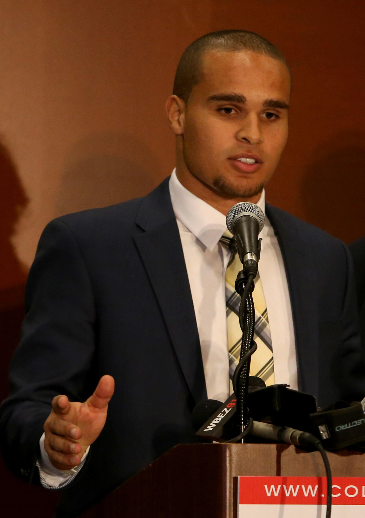 Kain Colter, a star quarterback and receiver who completed his college football career in December, announces that several Northwestern football players wish to join a labor union, during a press conference at the Hyatt Regency in Chicago, Tuesday, Jan. 28, 2014.