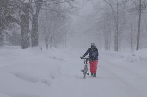 """This is insane,"" says Joanne McWalters, 30, as she makes her way home from work along West Boulevard in Hartford on Tuesday. Joanne says she rode her bike to work at the New York Sports Club in Blue Back Square and then pretty much walked her bike back home to Hartford."