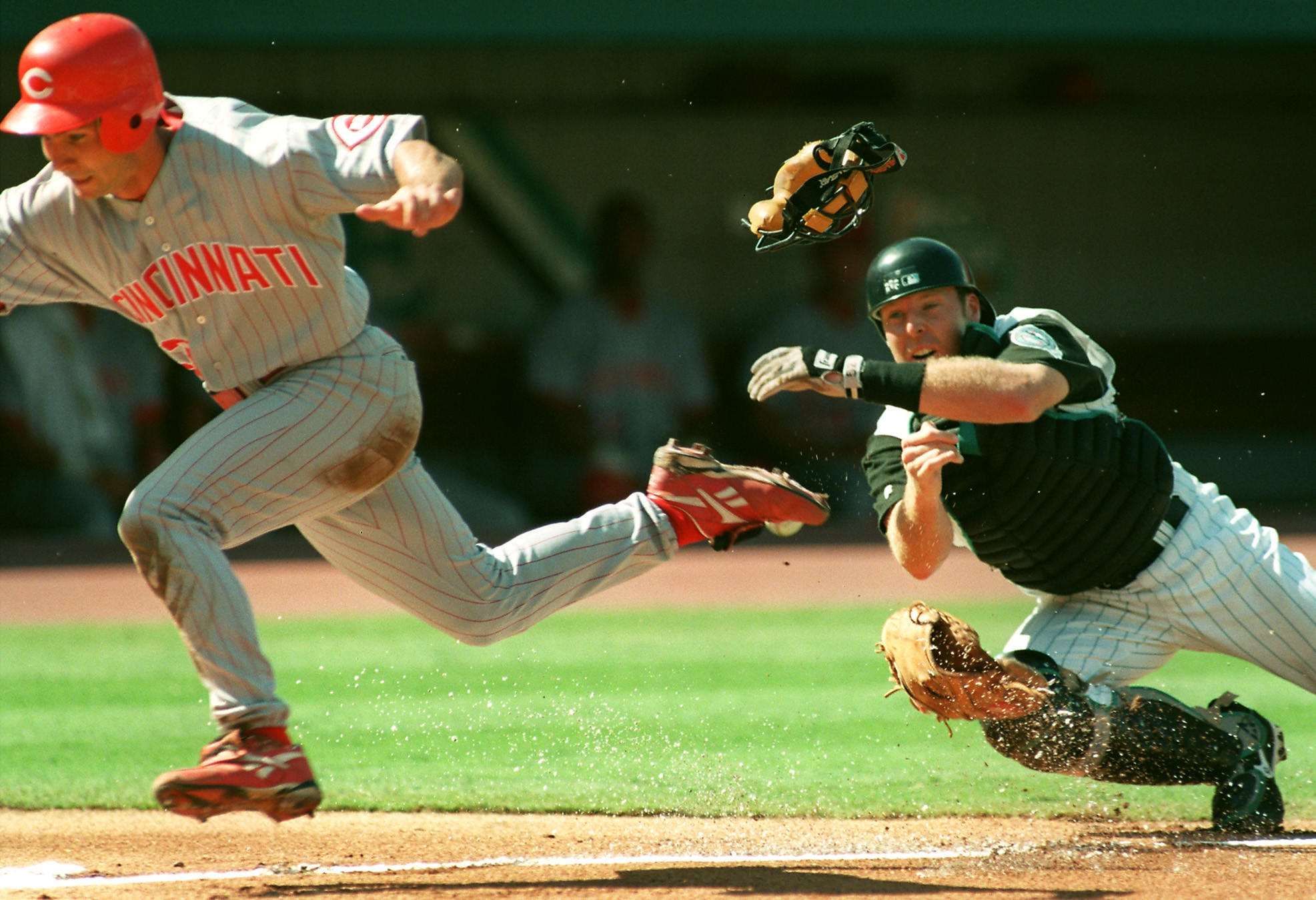 Plays like this one in 1998 involving ex-catcher and Marlins' manager Mike Redmond, and Chris Stynes of the Reds will be a thing of the past.