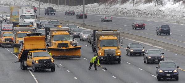 Traffic on outer loop of I-695 is reduced to one lane Saturday afternoon as vehicles pass State Highway Administration workers patching potholes.