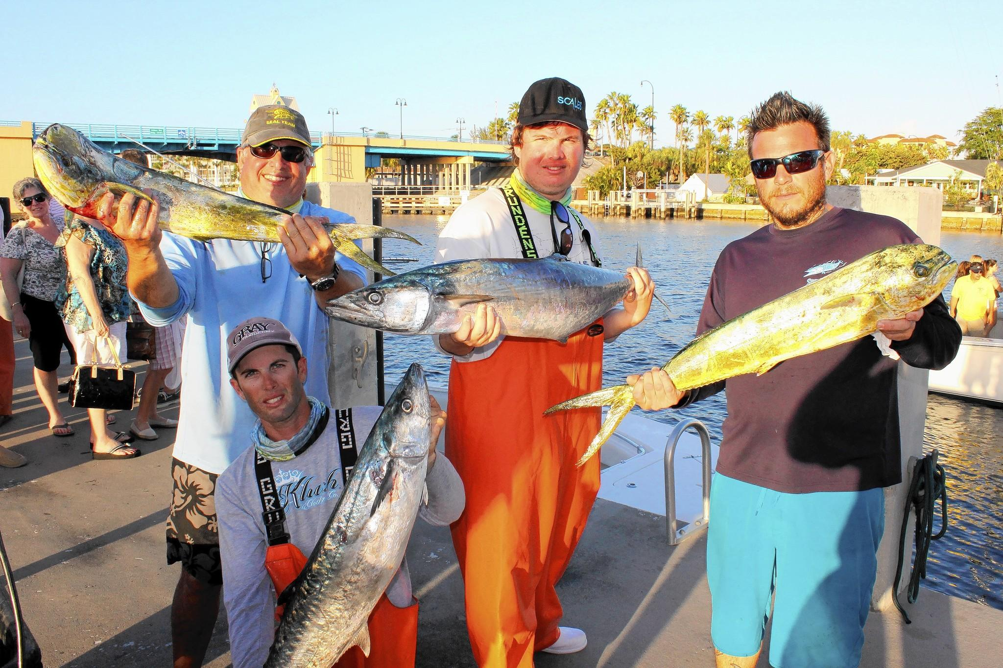 The Fourth Annual Two Georges at The Cove Billfish Tournament raised money for Jim & Jan Moran's Boys & Girls Club in Deerfield Beach. The crew from Adversity show off some of their catches of the day at the restaurants dock. Pictured are, kneeling: Nick Cardella. Standing, from left: Matt Cardella, Chris Cardella and Tommy Gargulio.