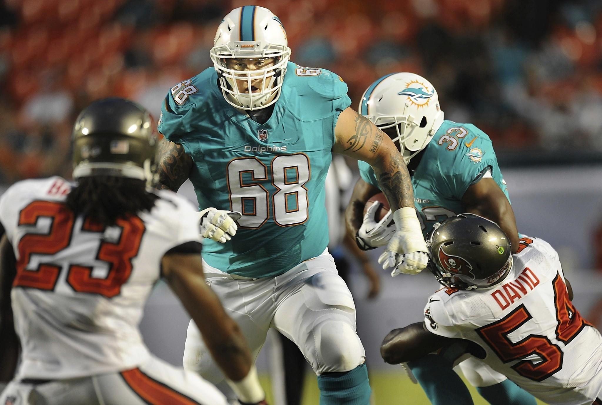 Richie Incognito is apologizing to Miami Dolphins teammate Jonathan Martin in the wake of an NFL-ordered probe of a bullying scandal.