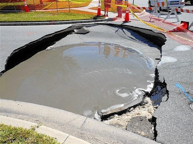 A sinkhole in Clermont was filled Tuesday by DeLand-based Bechtol Engineering and Testing.