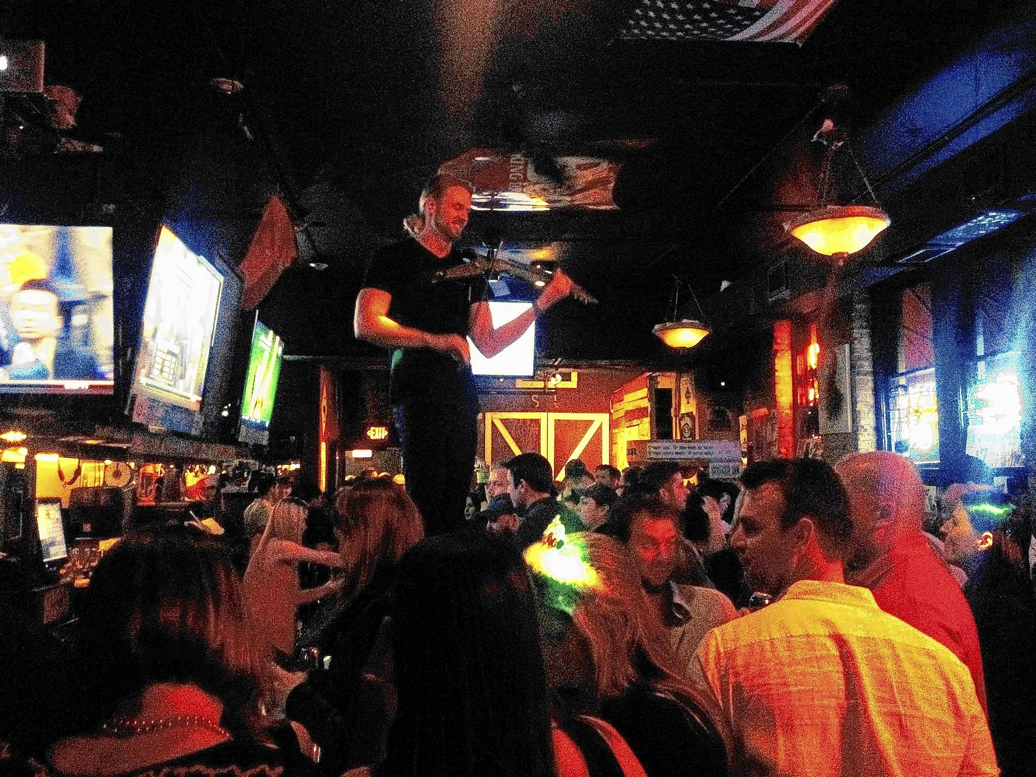 Fiddler Jared Burnett plays pied piper from the bar at Stagger Inn.