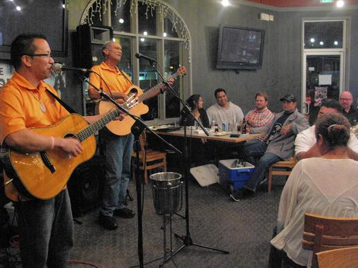 Hoku Zuttermeister (left) performs at Corner Kitchen, a restaurant in Honolulu where local musicians play most nights.