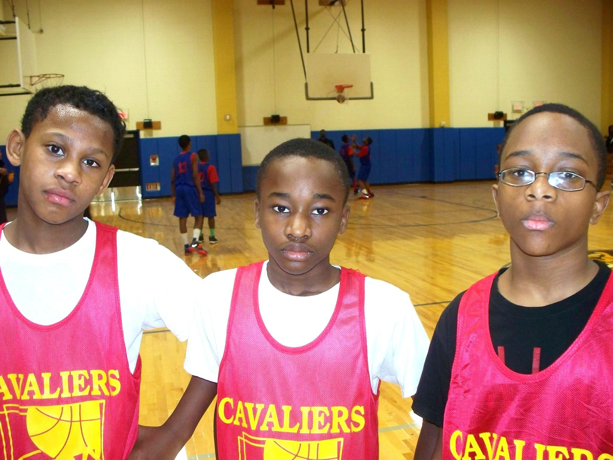 The BYBL 5th/6th grade division Cavaliers scored their first win of the 2014 season during week two of play. From left to right: Jalen Henry was the top scorer for the Cavs with 12 points, Jovan Hainsley added eight and Mitchell chipped in with four and scored the game winning basket in the second overtime period.