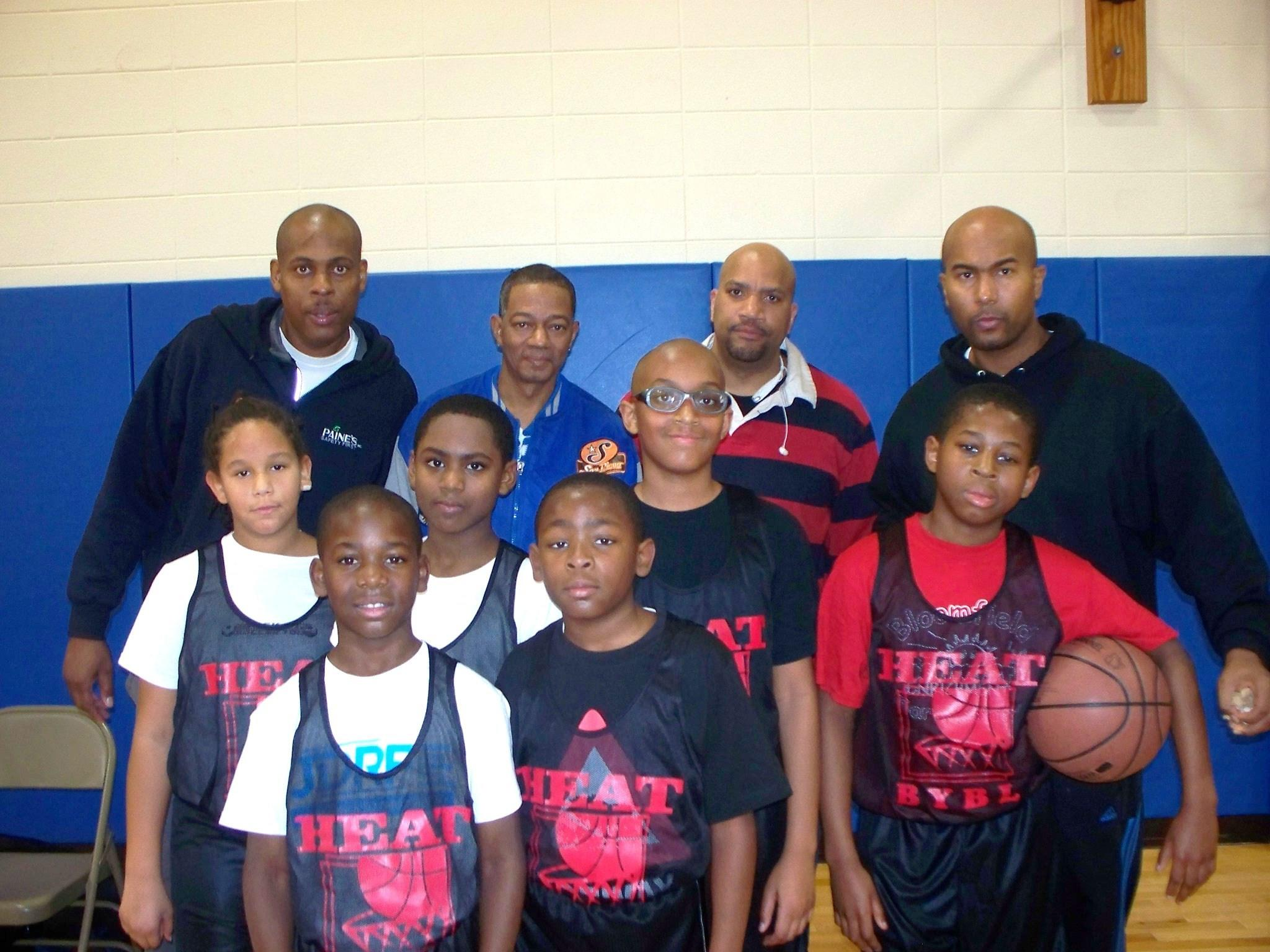 The BYBL 5th/6th grade division Heat players and coaching staff pose for a picture after defeating the Cavaliers 34-6 during week three of basketball on Saturday, Feb. 1.