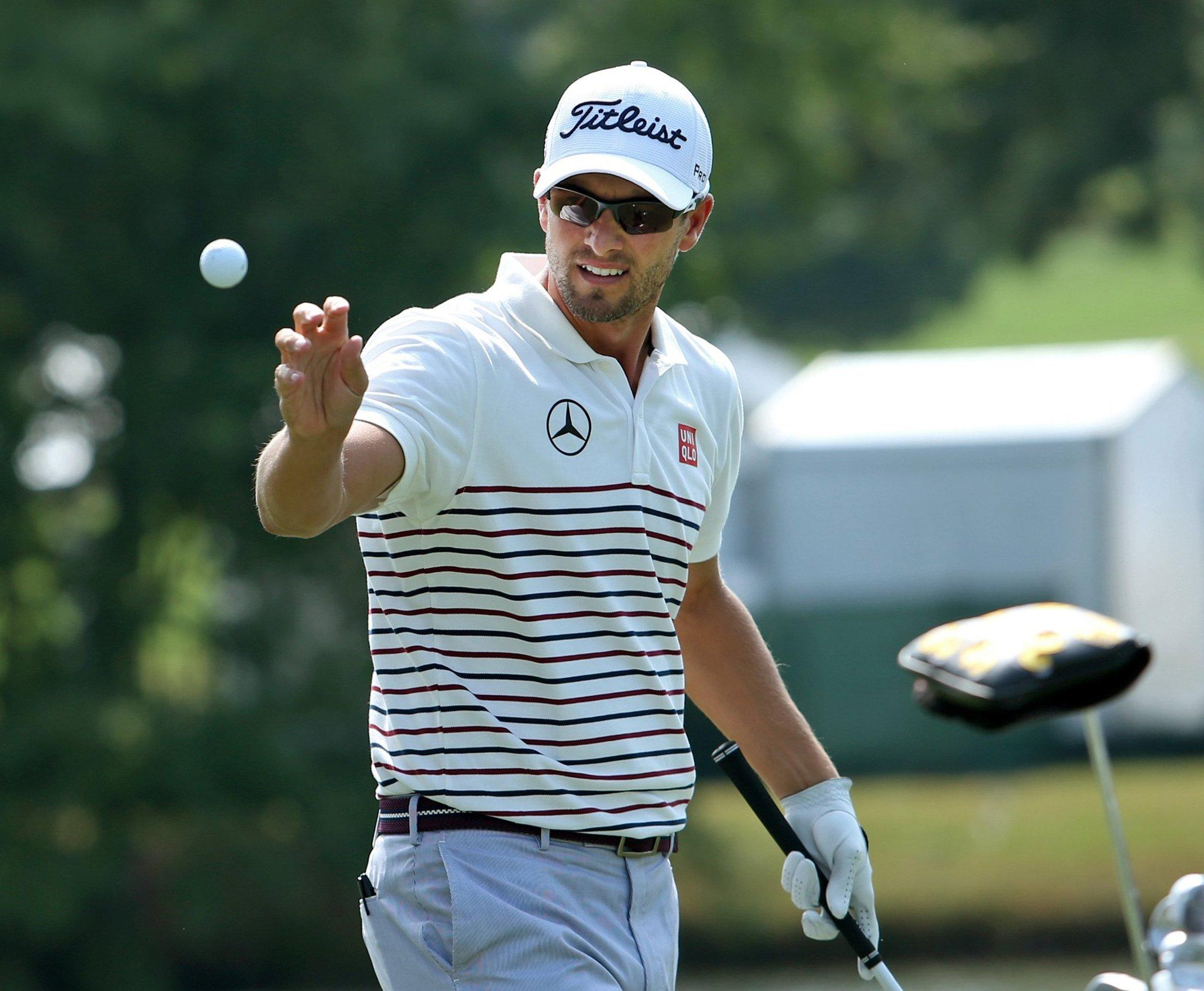 Adam Scott catches a ball from caddie Steve Williams during practice rounds of the Tour Championship at East Lake Golf Club in Atlanta.