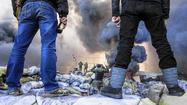 Ukraine uprising erupts in killings, arson, raids
