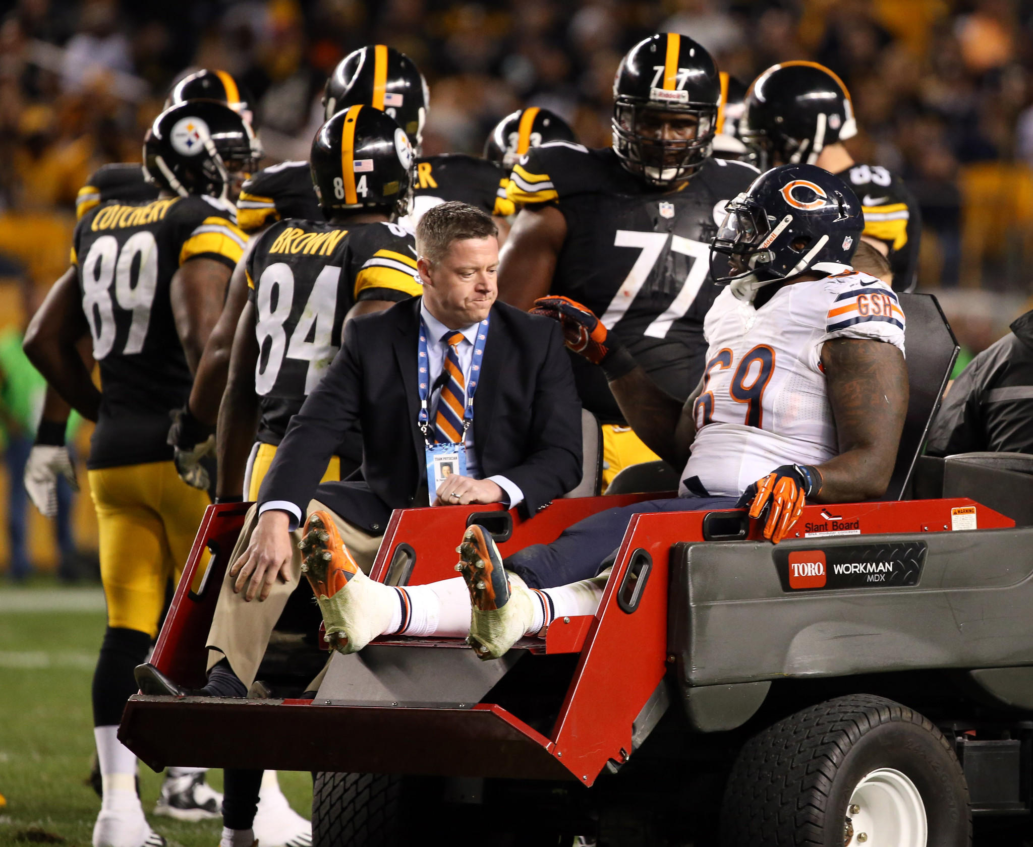 Bears defensive tackle Henry Melton is taken to the locker room with an injury against the Steelers.