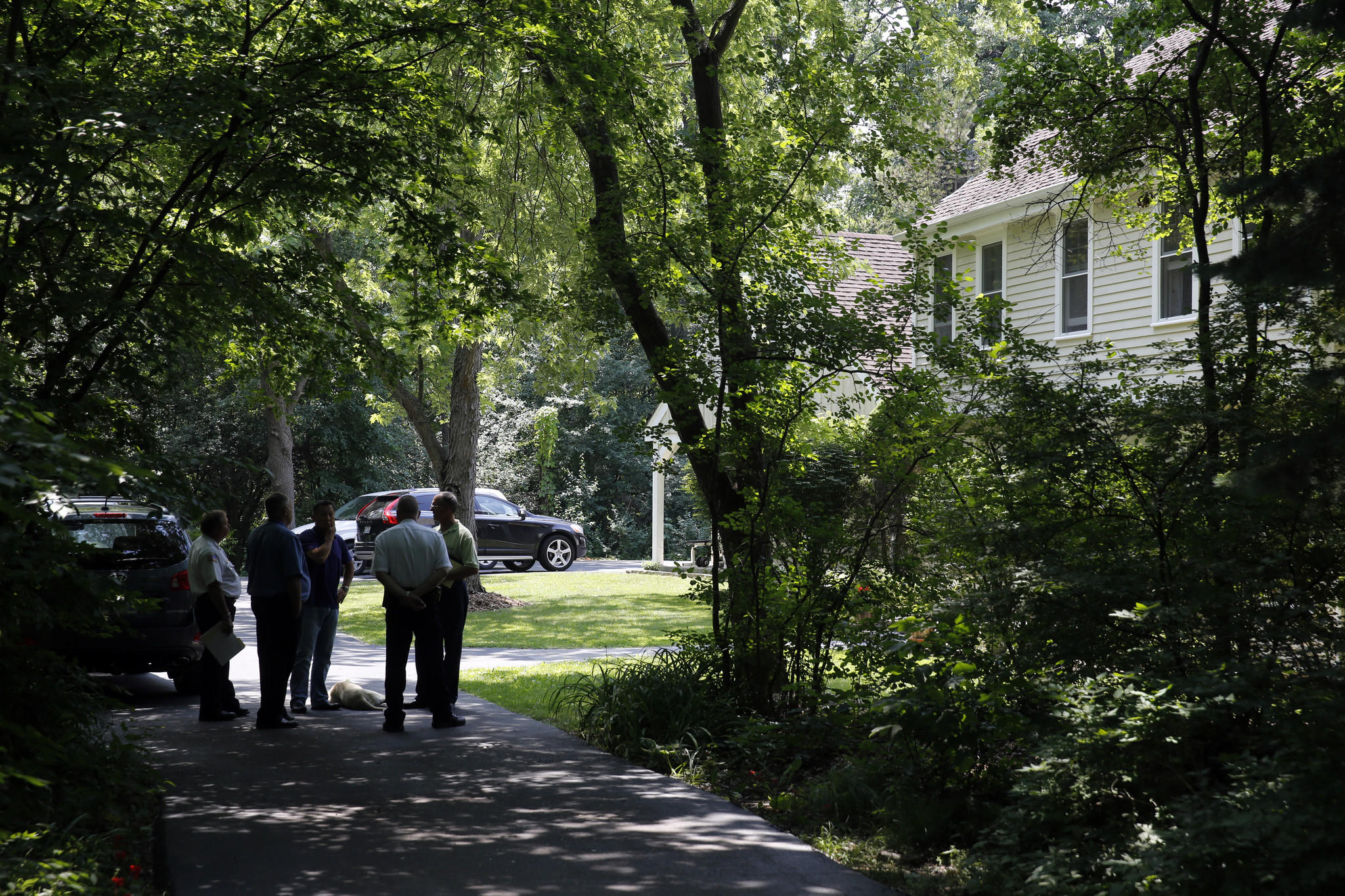 Several Lake County inspectors stand with Erik Sung outside of a property that Sung and his colleagues are trying to covert part of it from a residence to a Maum Meditation Center in unincorporated Vernon Township on June 20, 2013.