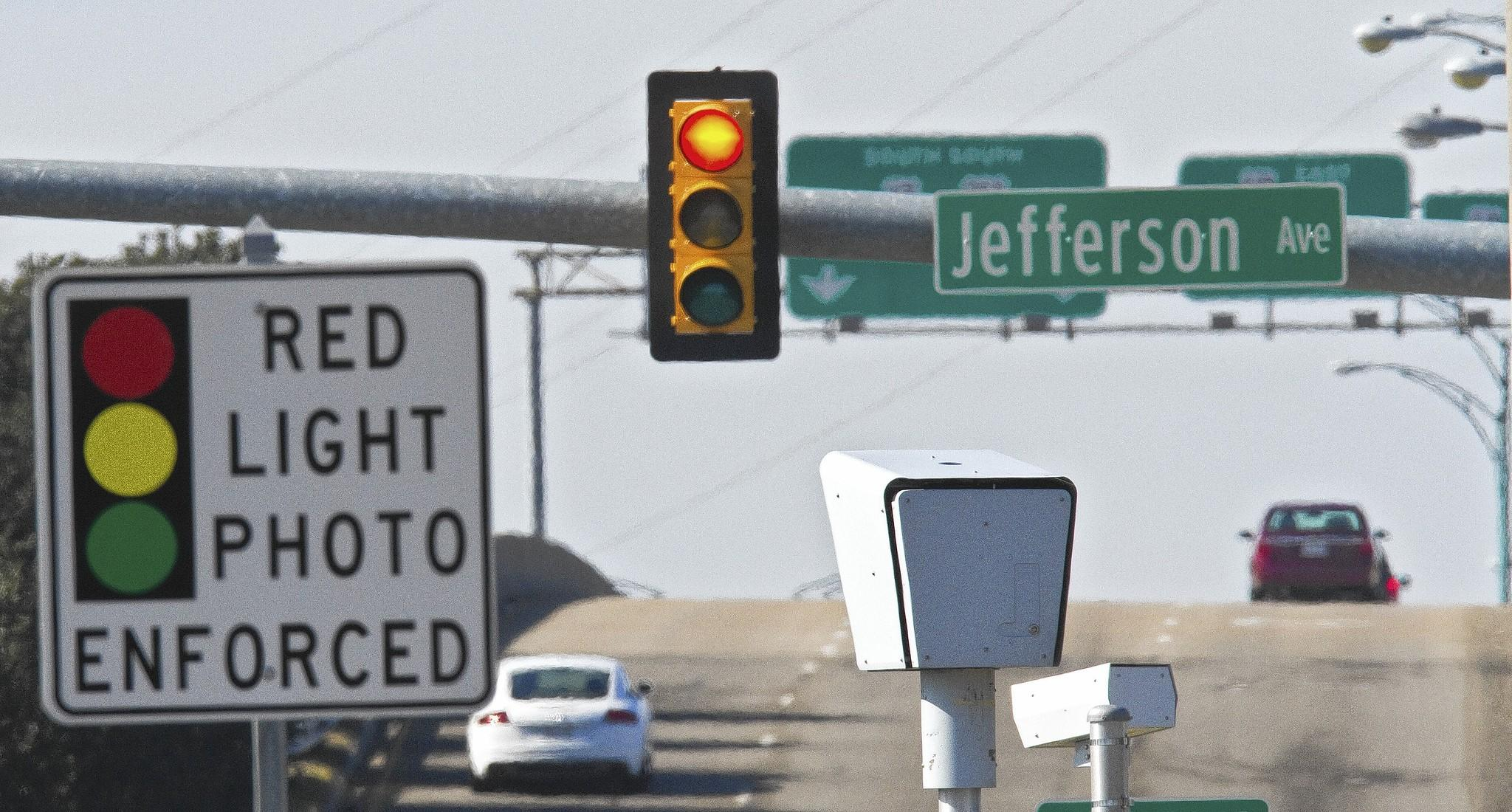 A red light camera monitors traffic at the intersection of Jefferson Avenue and Mercury Boulevard on Tuesday morning.