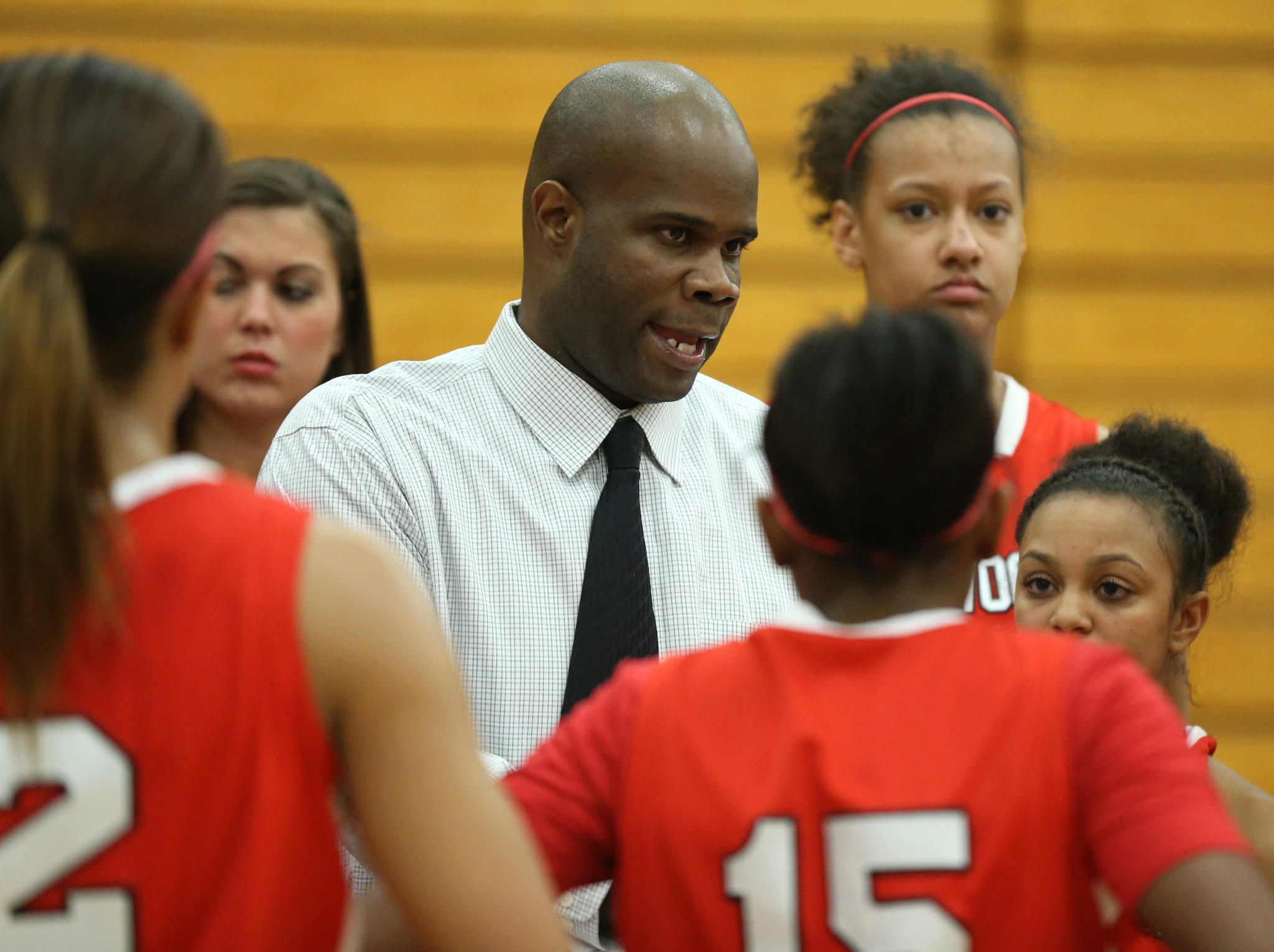 Homewood-Flossmoor coach Anthony Smith talks to his team in the second half against Lincoln-Way East at Lincoln-Way East High School on Feb. 13.