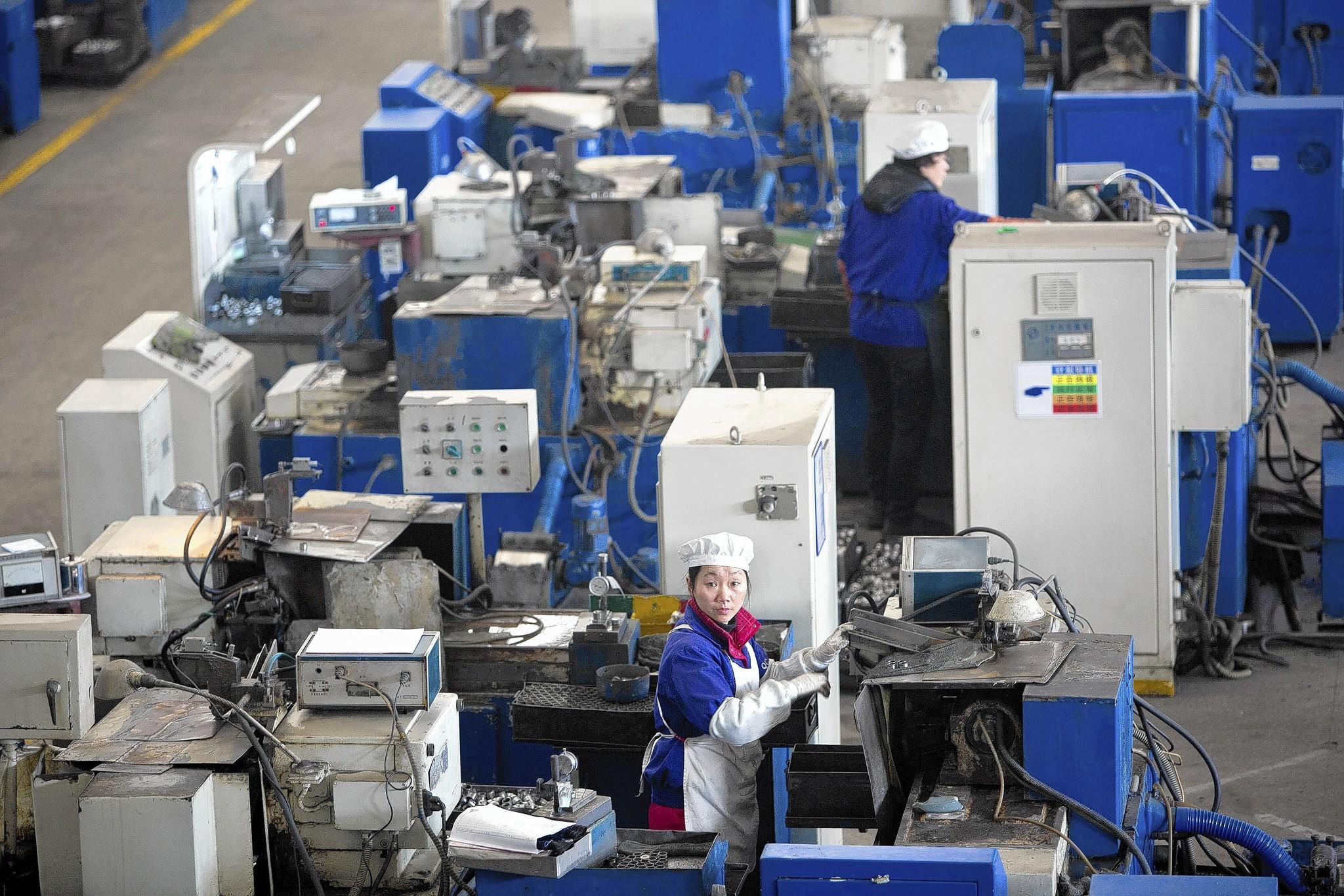 The production line of a Wanxiang factory in China. With its purchase of Fisker Automotive, Chinese-owned Wanxiang America, based in Elgin, transforms from a maker of vehicle parts into a builder of $100,000 plug-in electric hybrid cars.