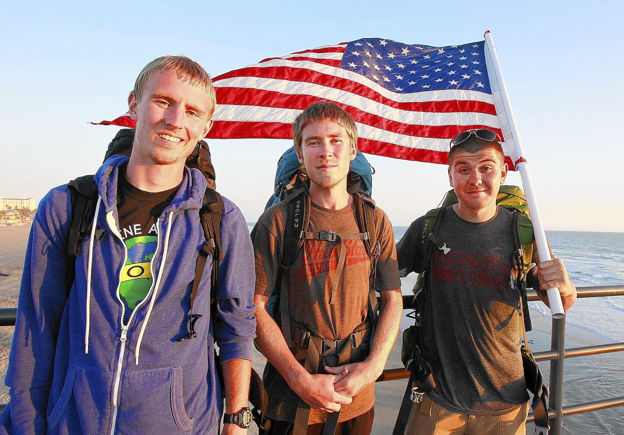 George Crawford, Drew Babcock and Mike Ross happily stand on the Huntington Beach Pier after they arrived at the Pacific Ocean after walking across America from Connecticut for the Livestong Foundation in an effort to fight cancer.