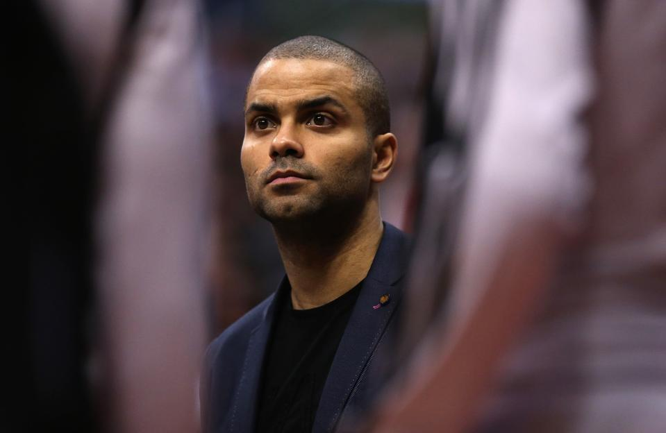 Tony Parker watches from the bench