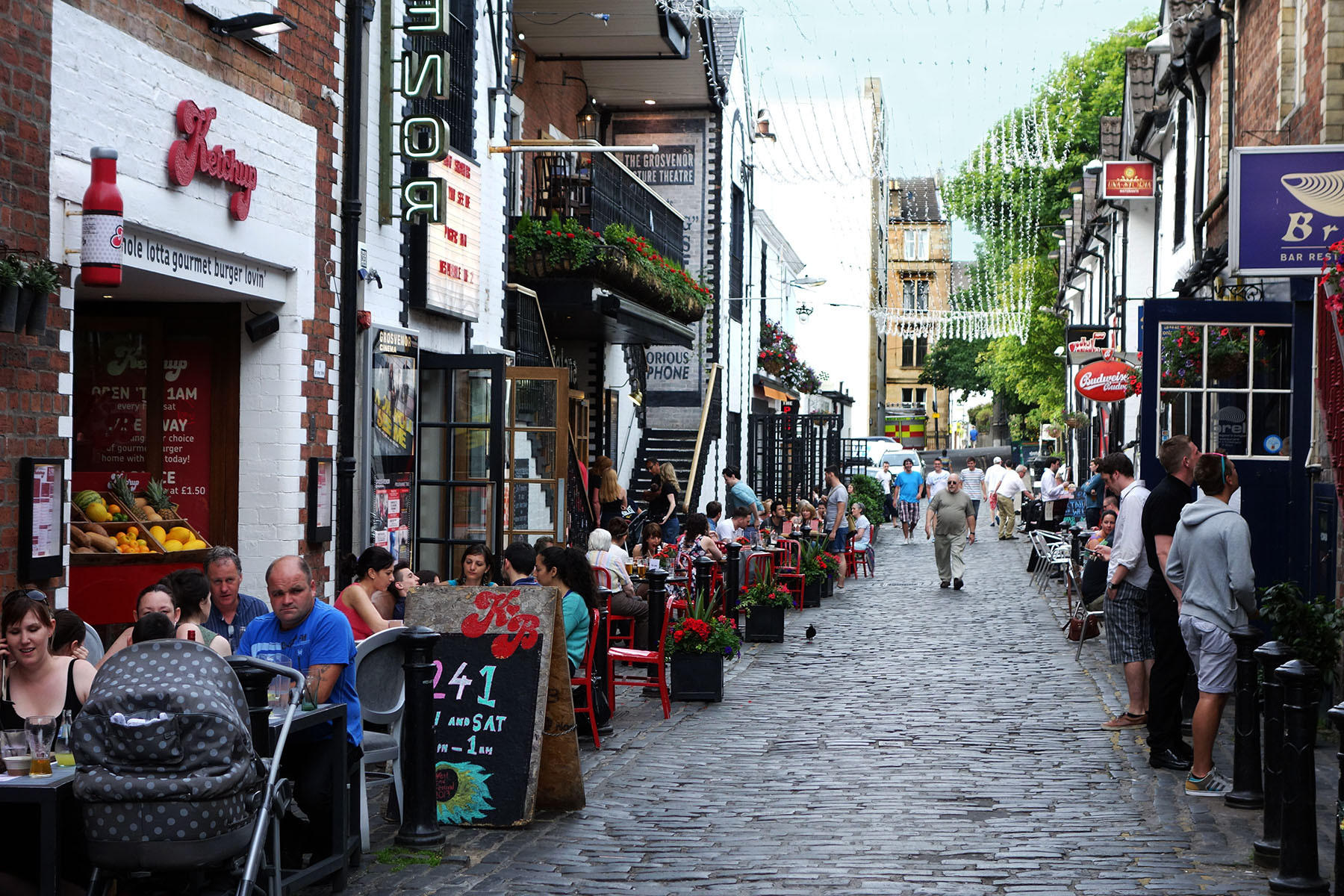 Ashton Lane is lined with an array of restaurants and bars, most with tables out front and convivial gardens in the back.