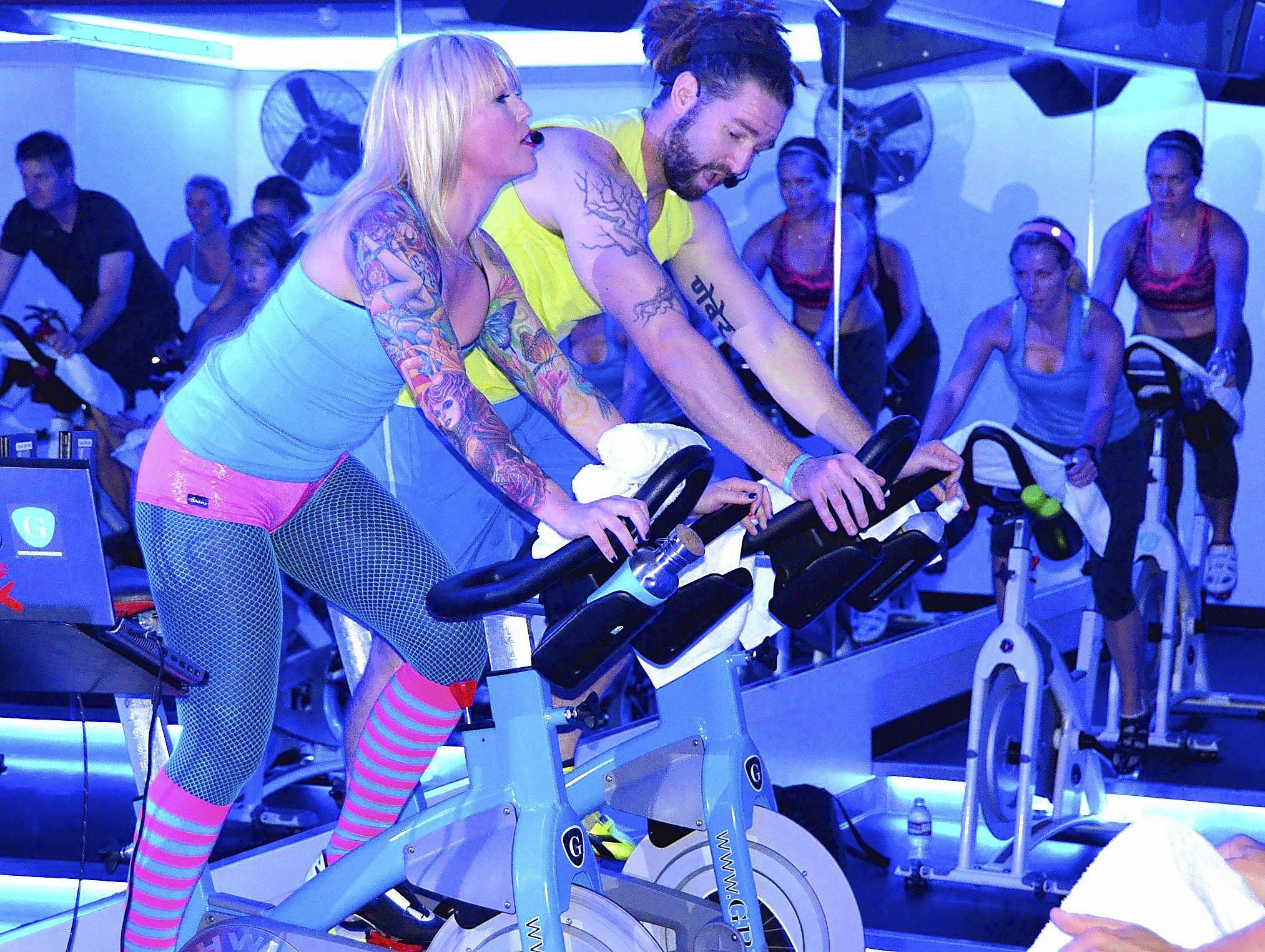 Dani Gallinger and Matt Bourne lead the workout during the GRIT Ride For CHOC Charity event benefitting CHOC Children's Heart Institute on Saturday.