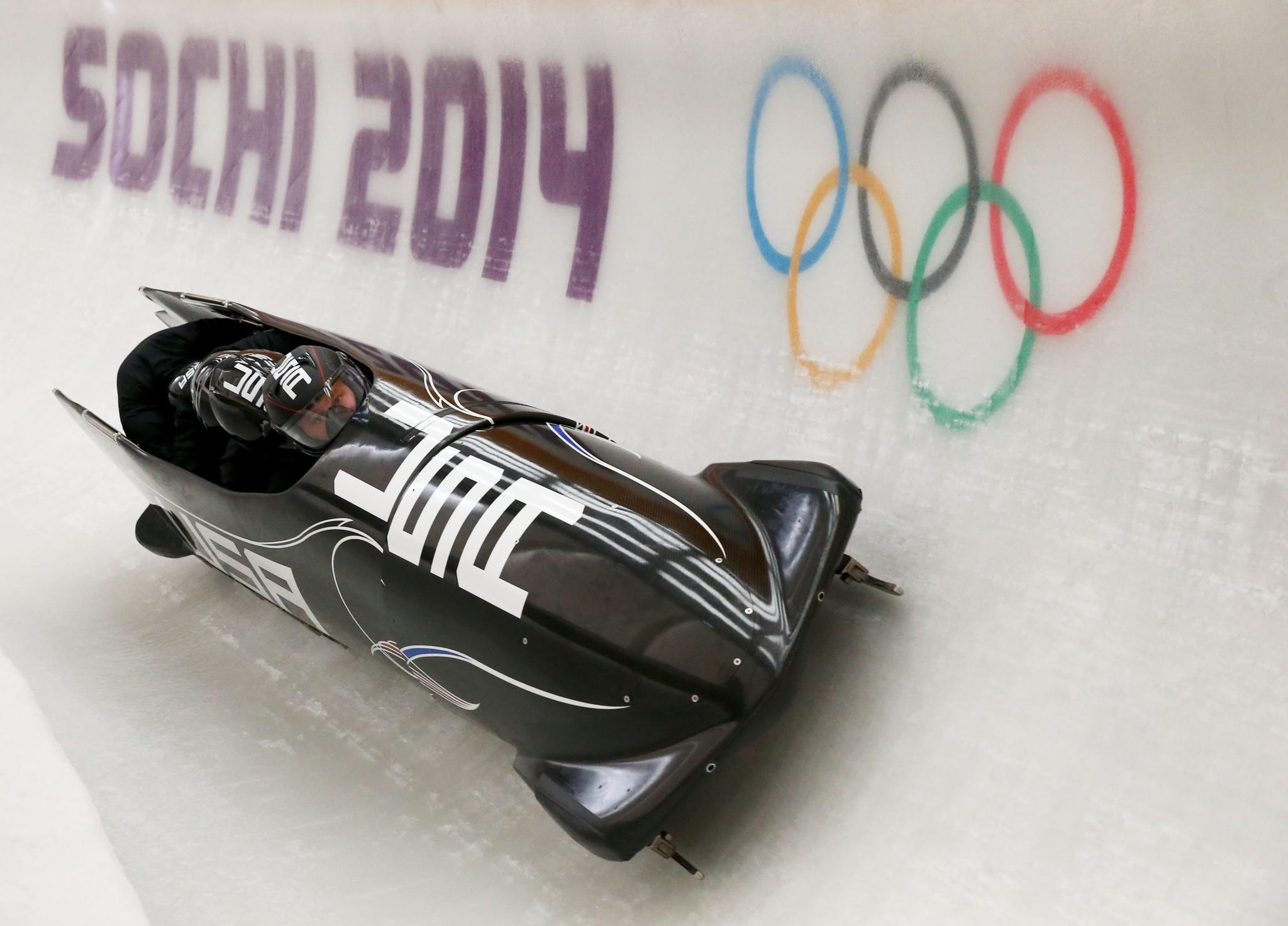 Steven Holcomb of United States pilots a run during a four-man bobsled practice session.