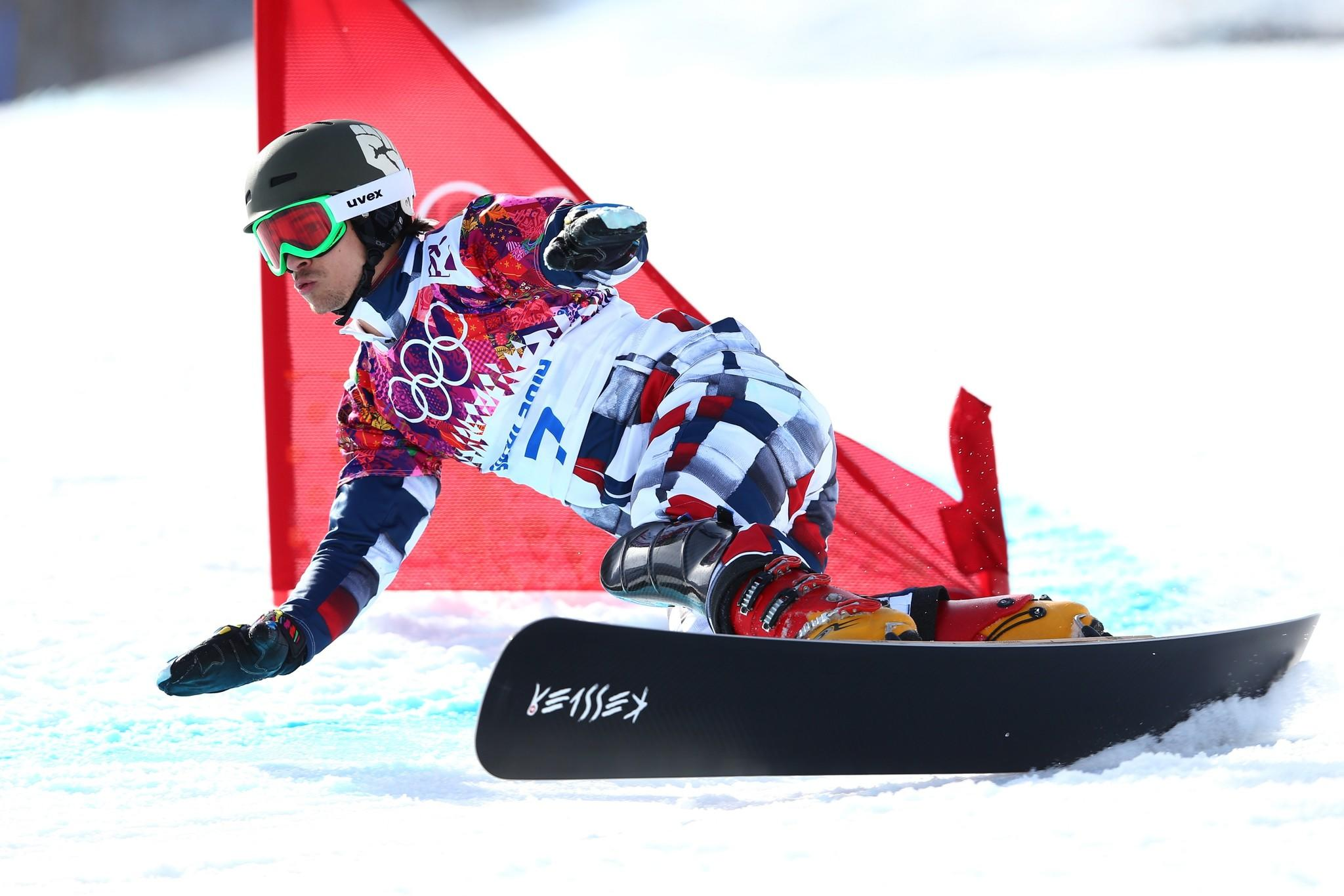 Vic Wild of Russia competes in the Snowboard Men's Parallel Giant Slalom.