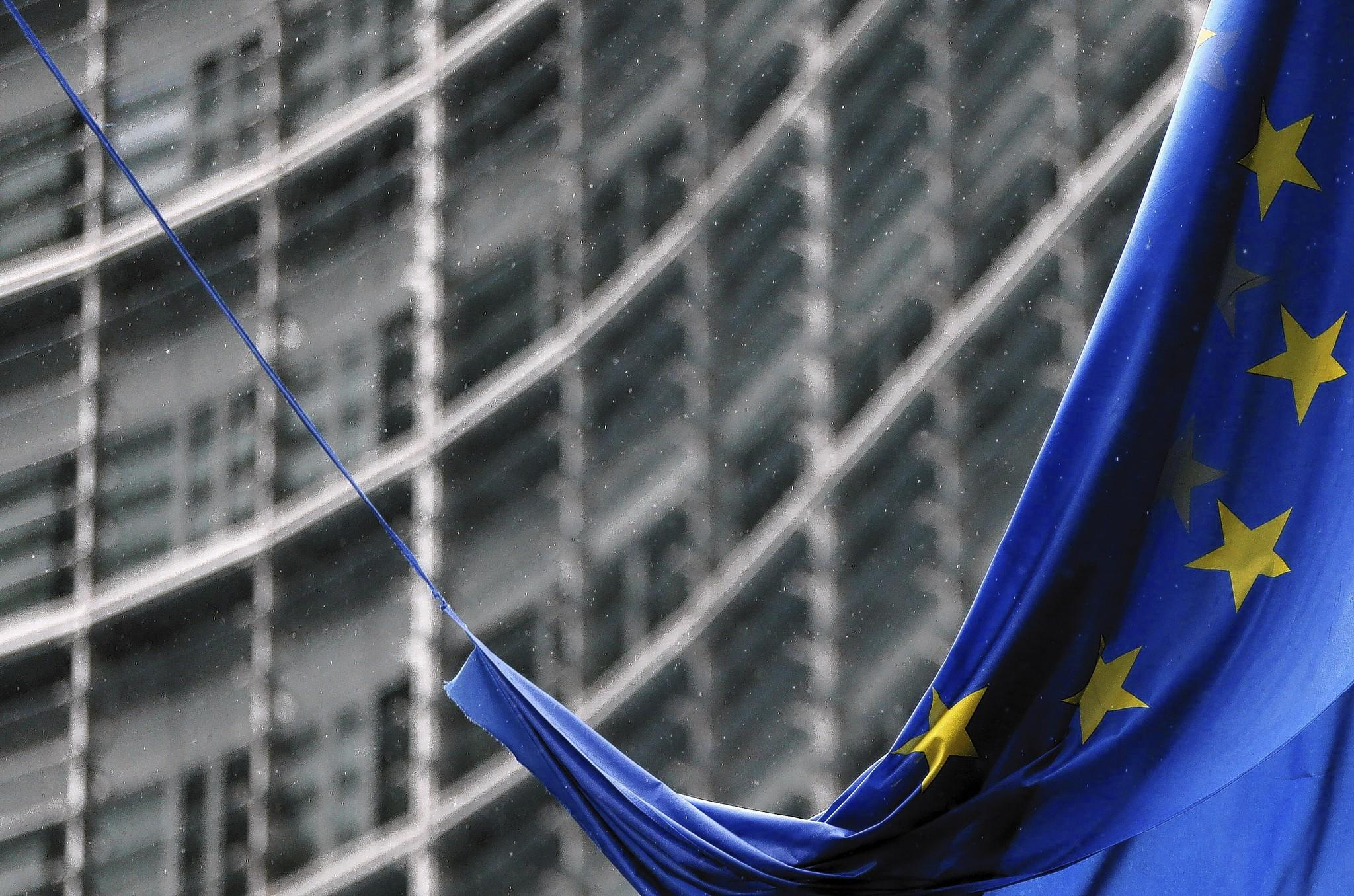 An European Union flag hangs outside the EU Commission headquarters in Brussels.