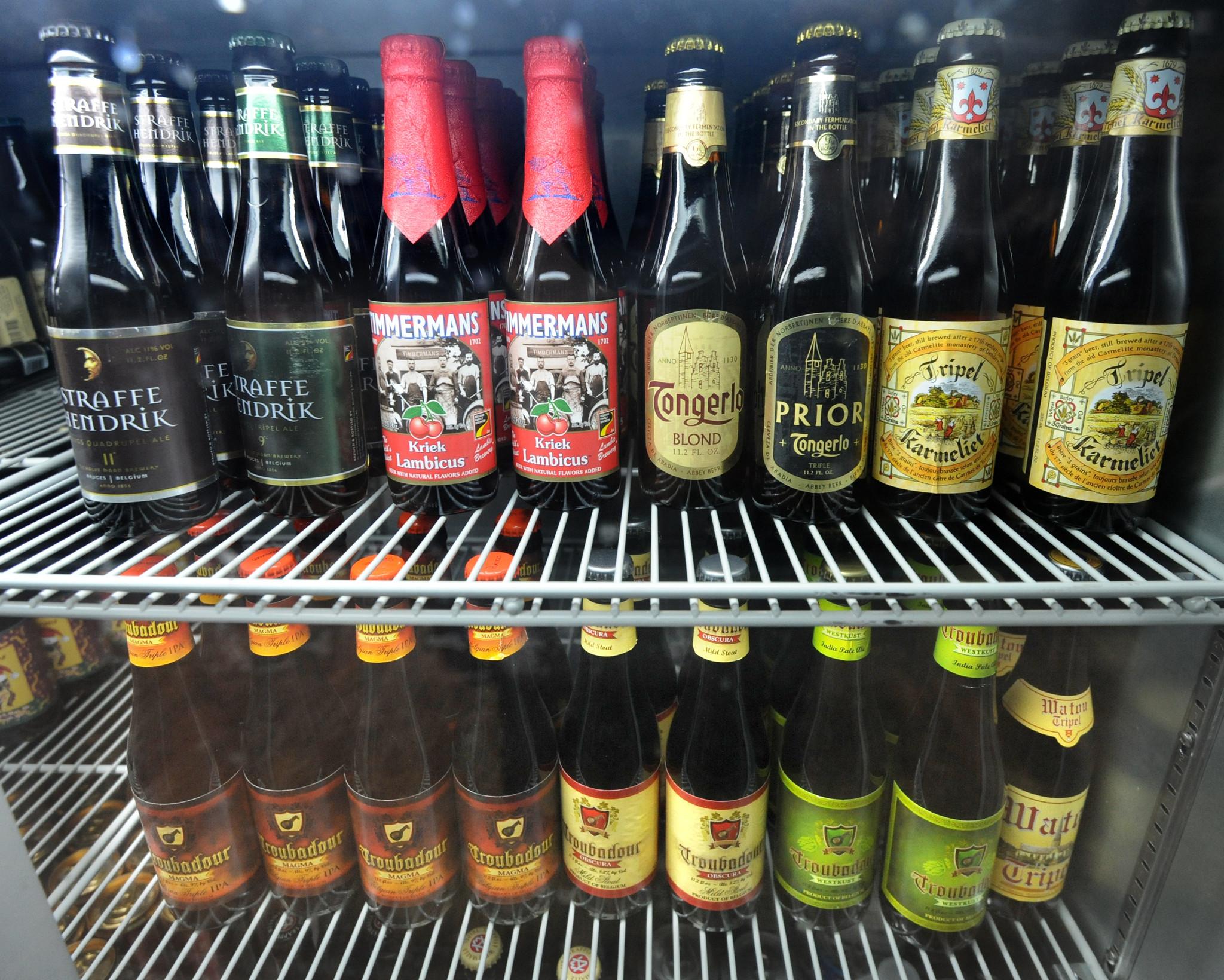 Belgian beer is stocked in several refrigerators at De Kleine Duivel in Hampden.
