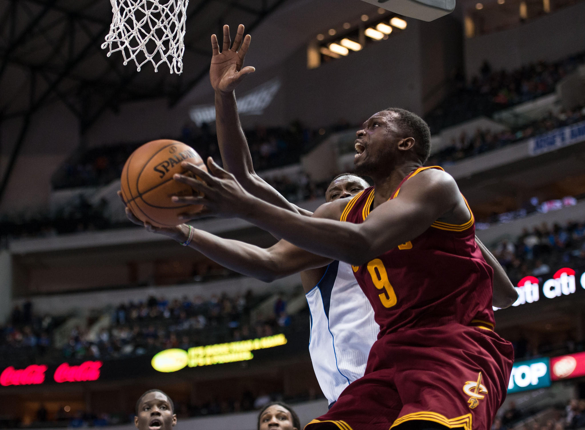 Cleveland Cavaliers small forward Luol Deng (9) drives to the basket past Dallas Mavericks center Samuel Dalembert (1) during the second half at the American Airlines Center. The Mavericks defeated the Cavaliers 124-107.